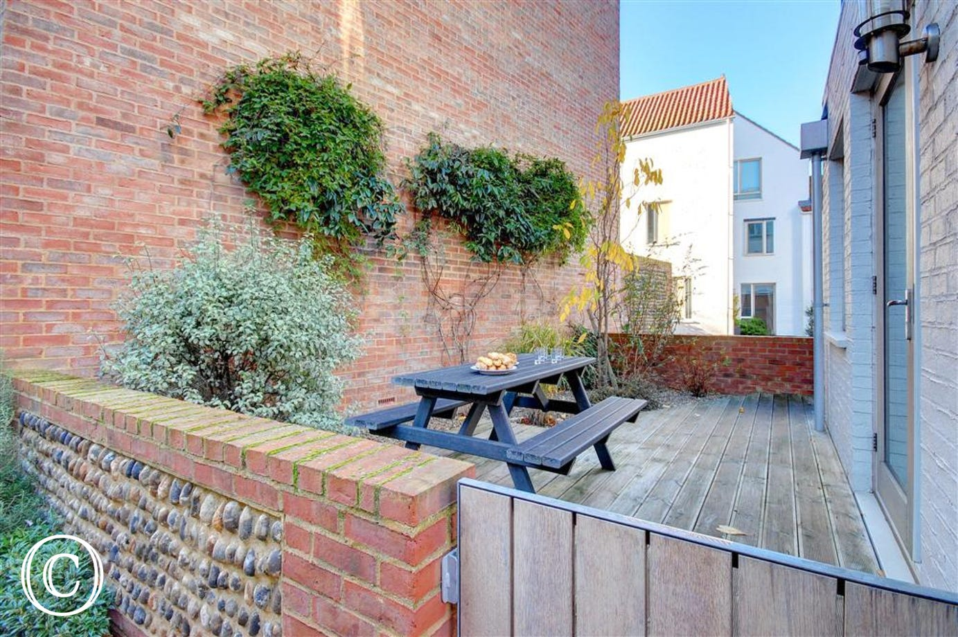 Enjoy an afternoon tea at the picnic table in the Southwold sun in this courtyard garden at Turnstone's.