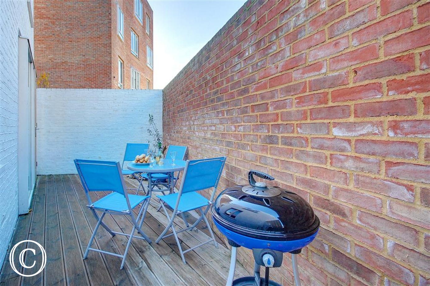 This walled seating area with BBQ can be accessed from the sitting room.