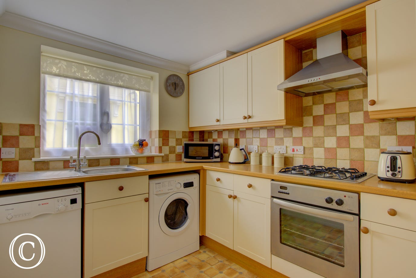 This warm beige coloured kitchen has all one will need for their self cater stay at Wisteria Cottage.