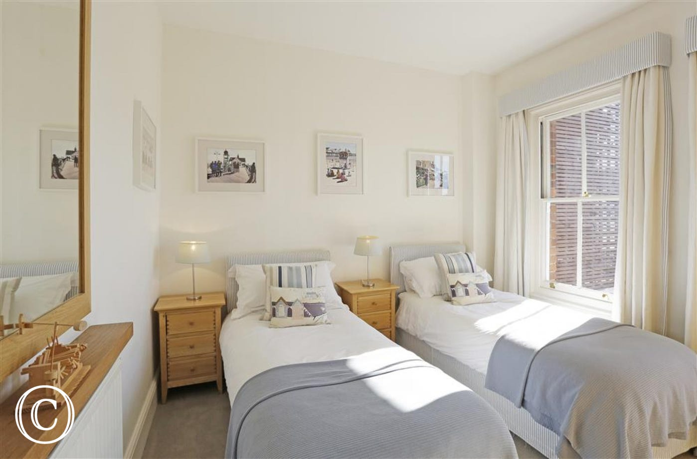 This twin bedded room can be left as is or made up as double if two couples are staying.