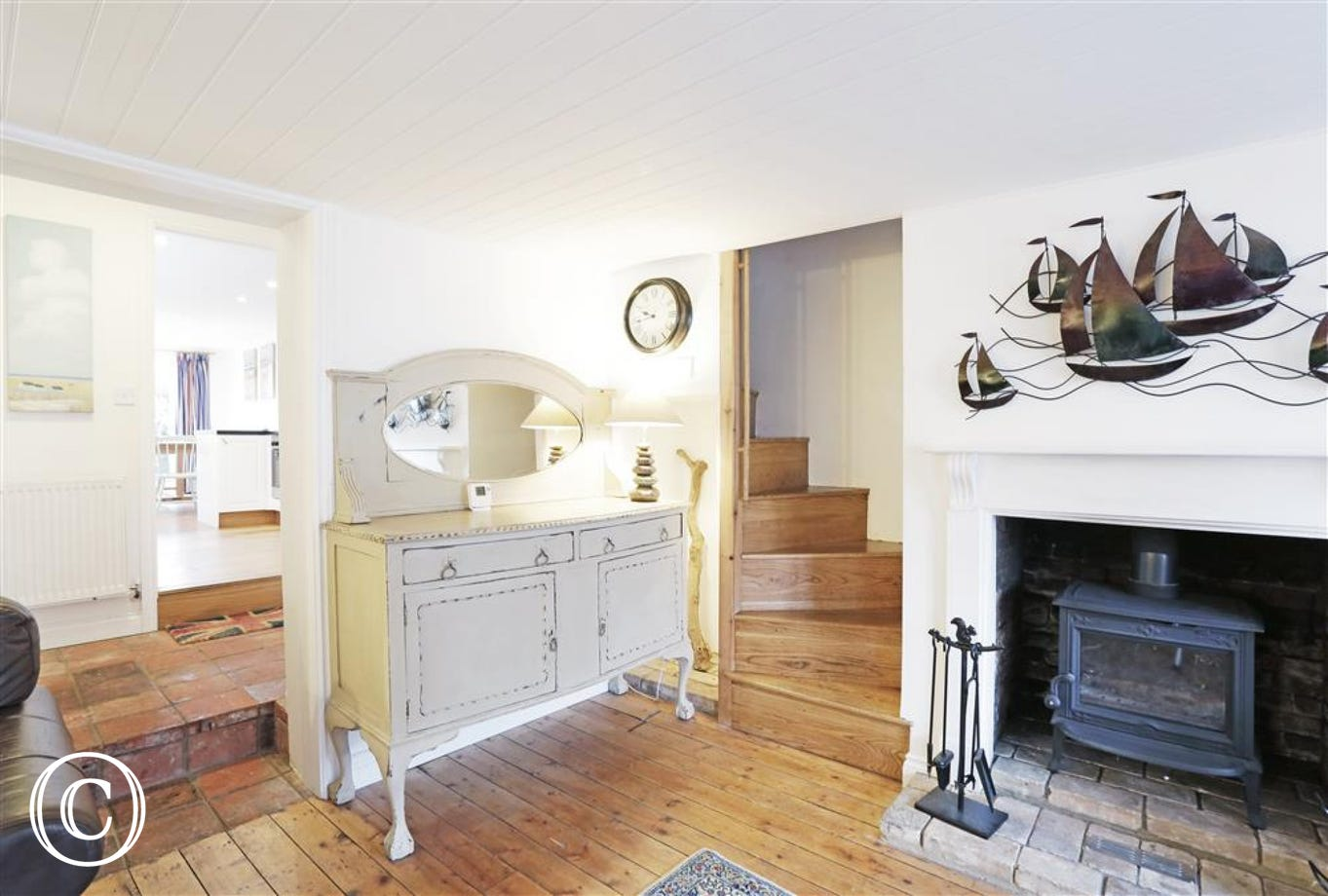 Enjoy this gorgeous wood burner which is centrally located at the end of the sitting room to emit warmth and comfort.