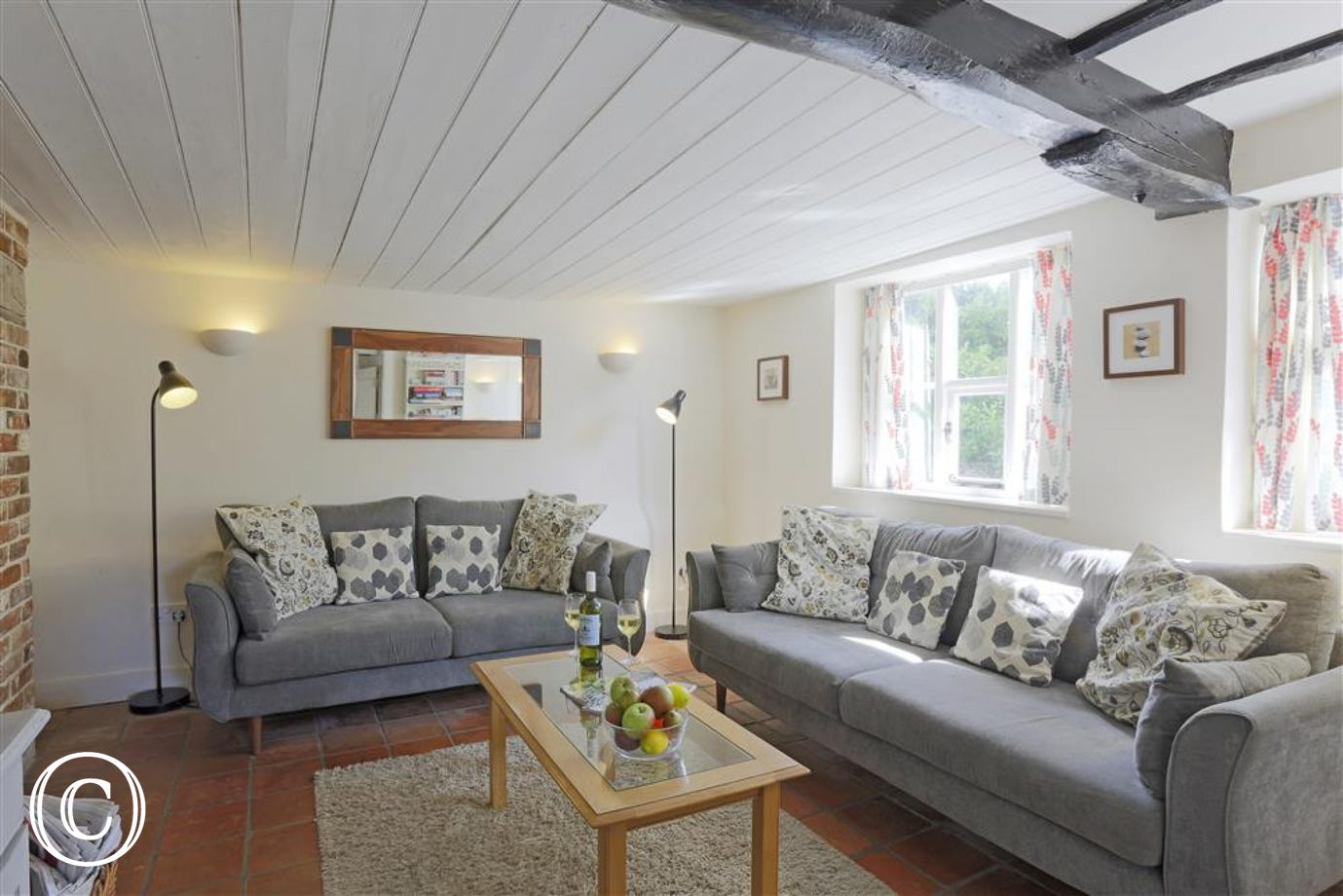 Stylish and comfortable farmhouse sitting room.