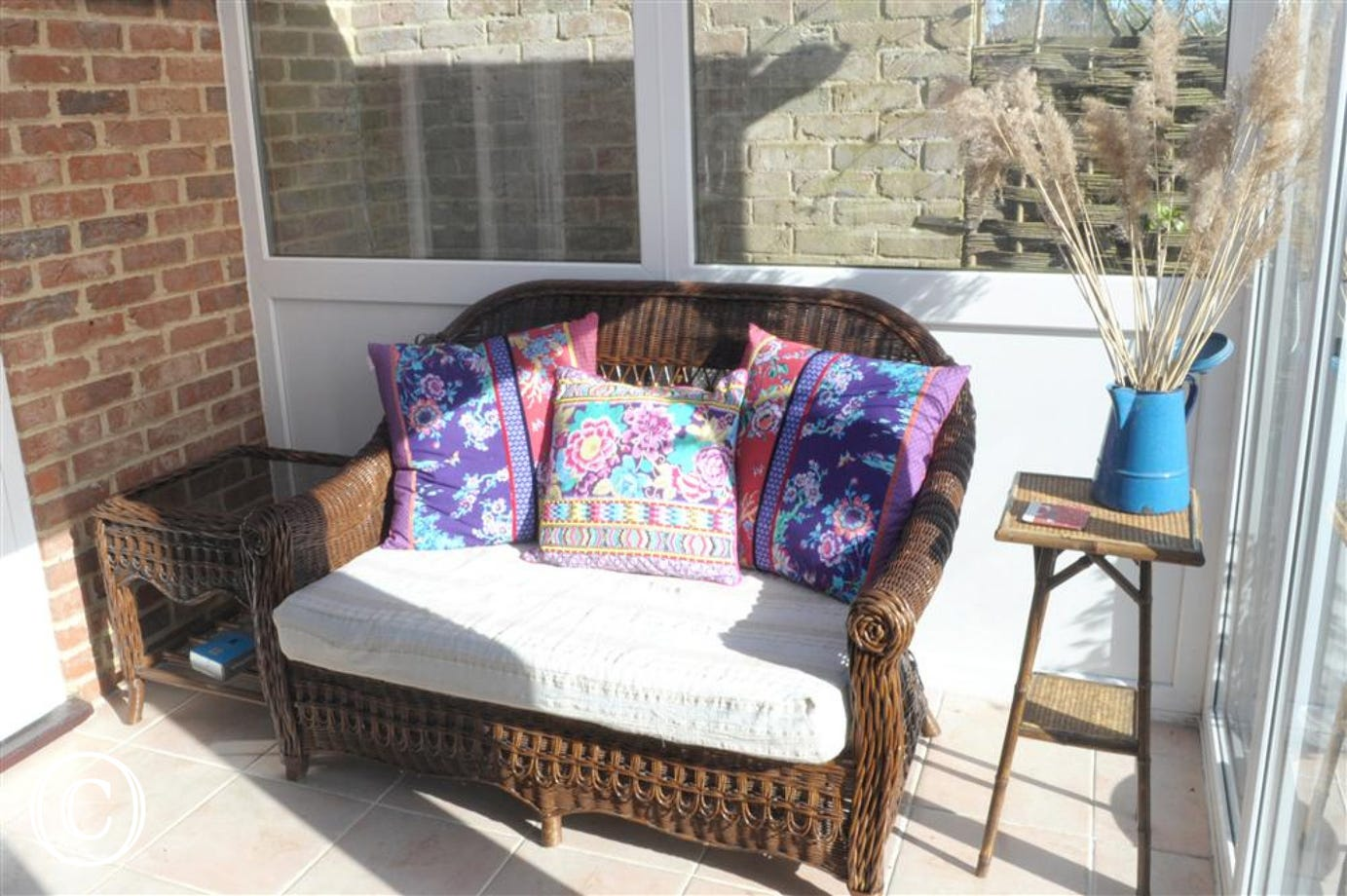This dining room conservatory also has this nice wicker sofa with soft padding for the seat so you can enjoy the sunshine.