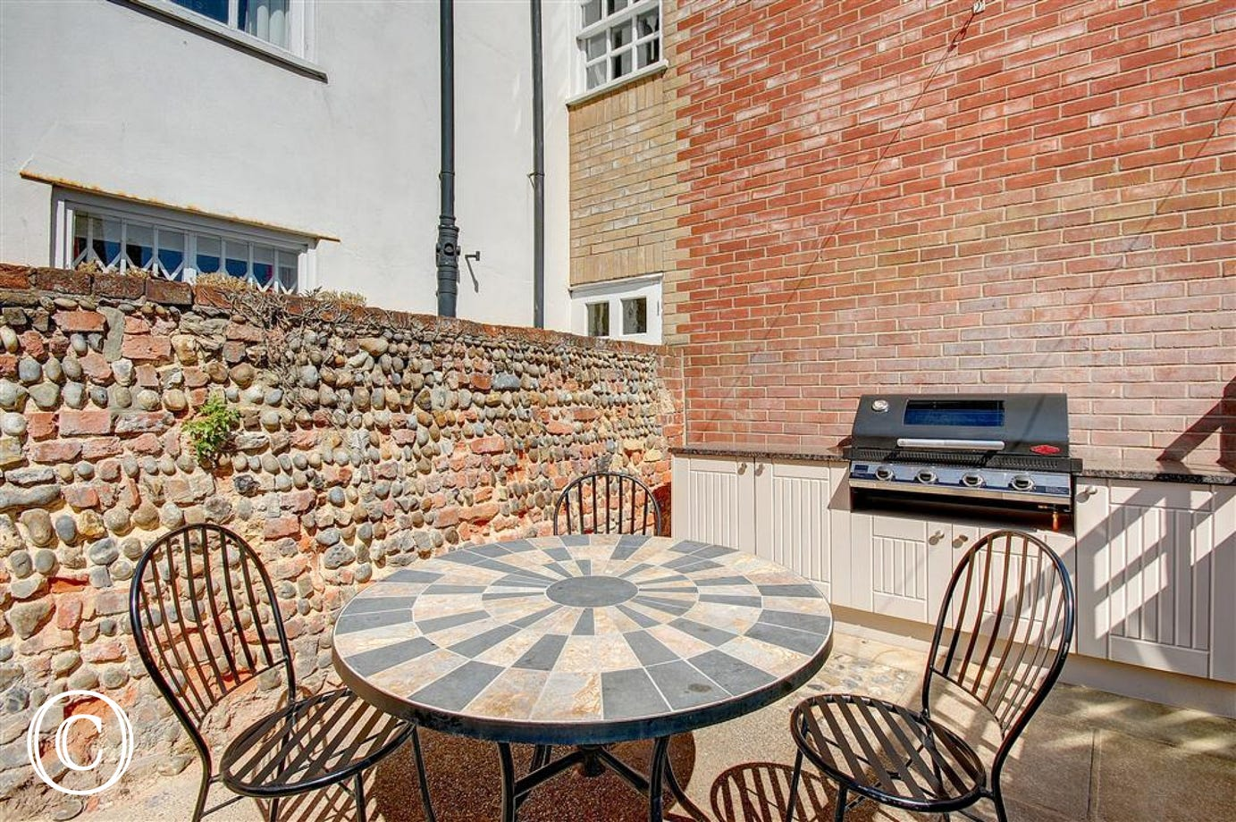 Enjoy this pretty courtyard garden with table and chairs and fitted BBQ kitchen so you can enjoy the Southwold sun.