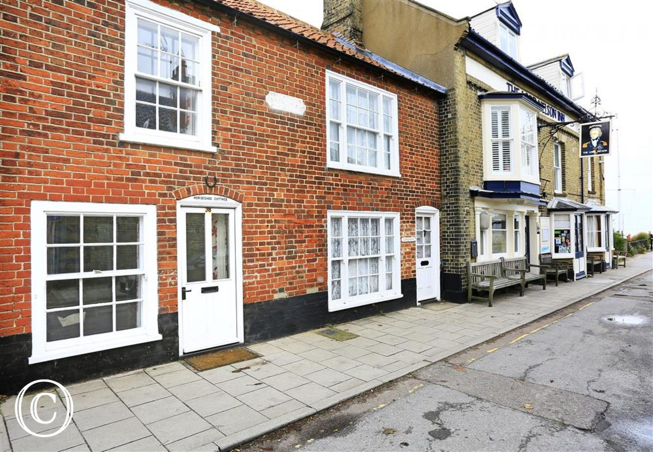 Horseshoe Cottage is in the heart of Southwold with the high street to the right and the beach to the left.