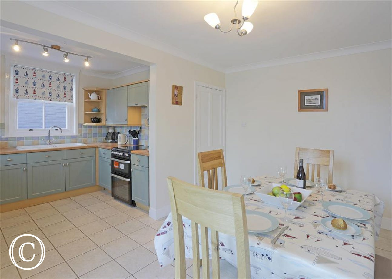 A spacious open plan kitchen and dining area.