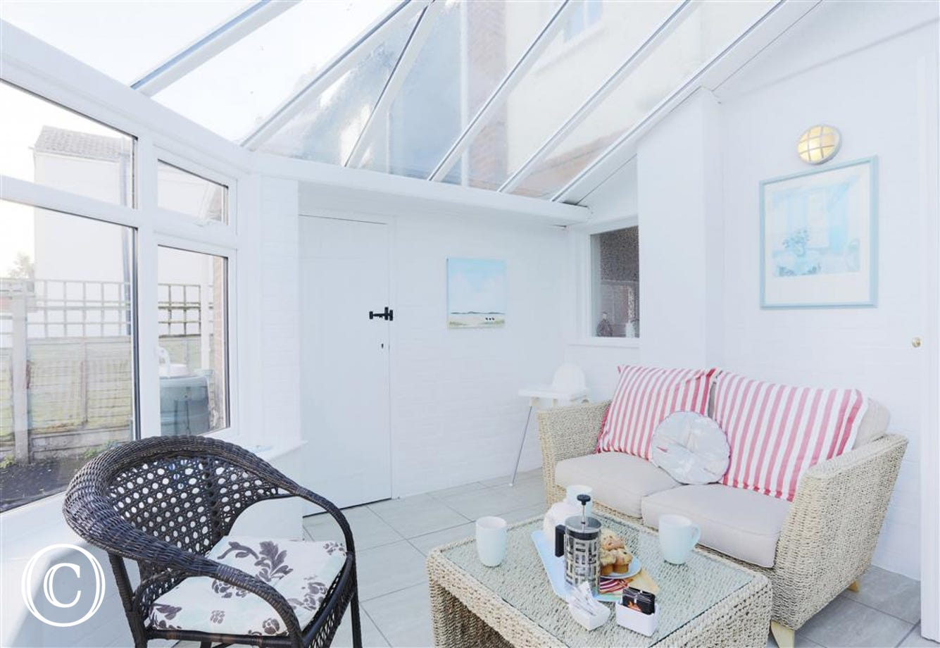 This bright and roomy conservatory is a great alternative as somewhere for you to dine or relax in.