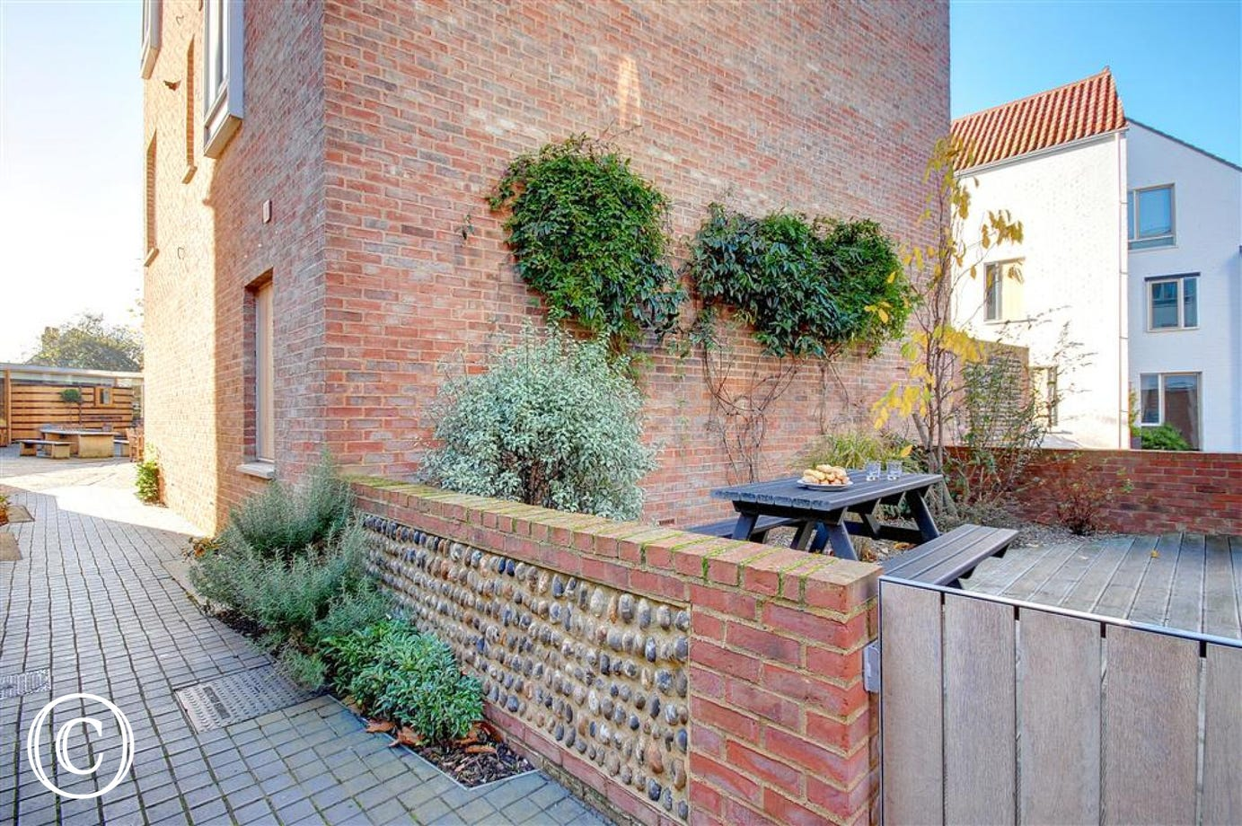 This courtyard garden area has double access one from the car and the other to the Adnams kitchen and Cellar coffee shop.