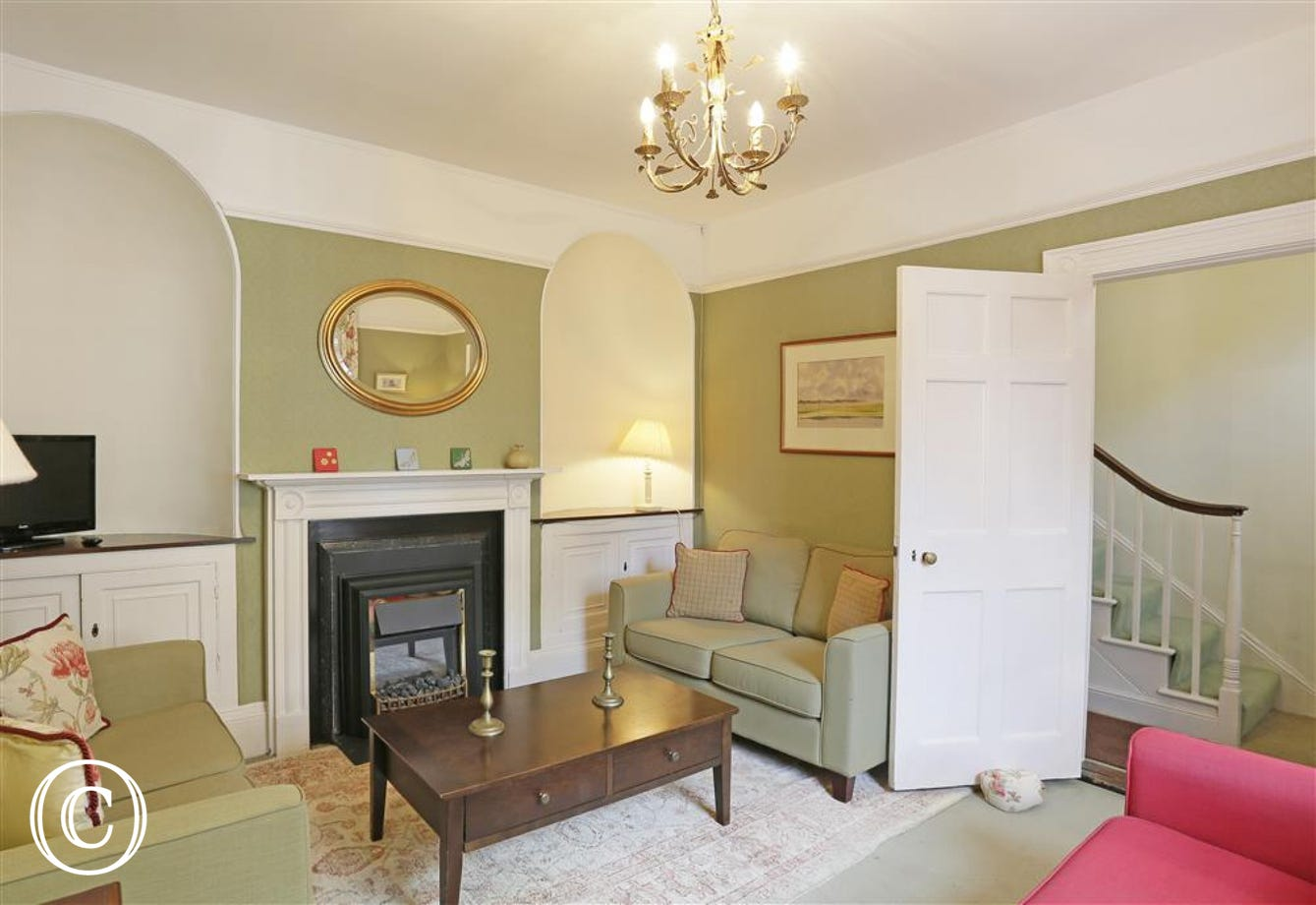 Take in the pretty features of this prime location property with its arched alcoves and rustic lights.
