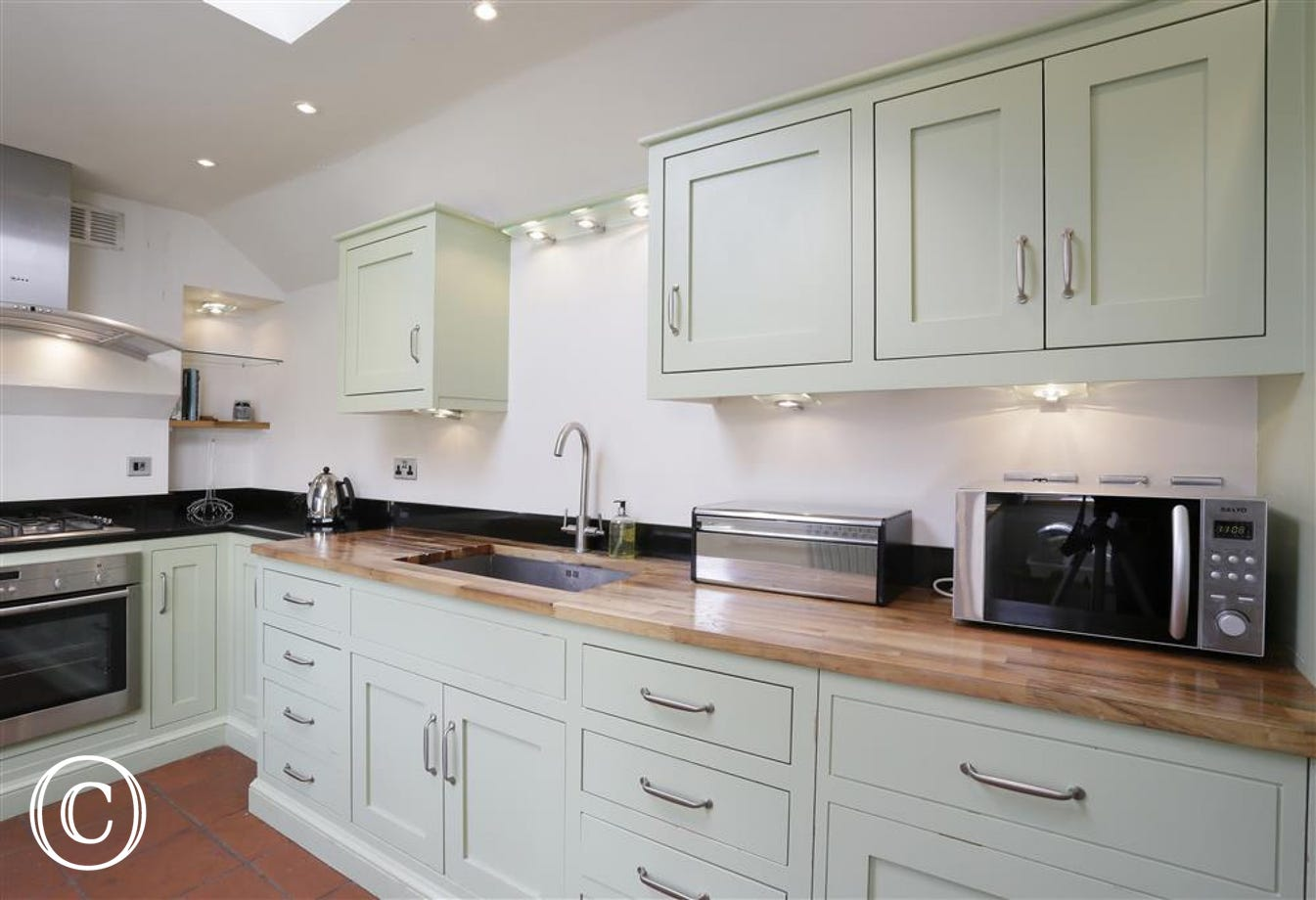 This generous kitchen has plenty of storage space and houses all the essentials one will need for a self-cater stay