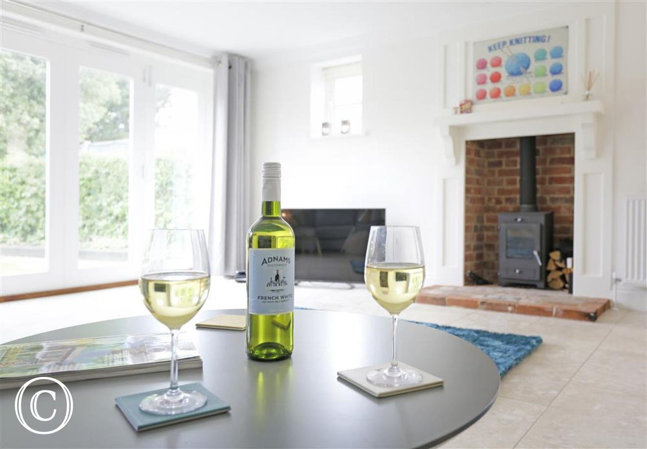Relax in the sitting room with a glass of wine
