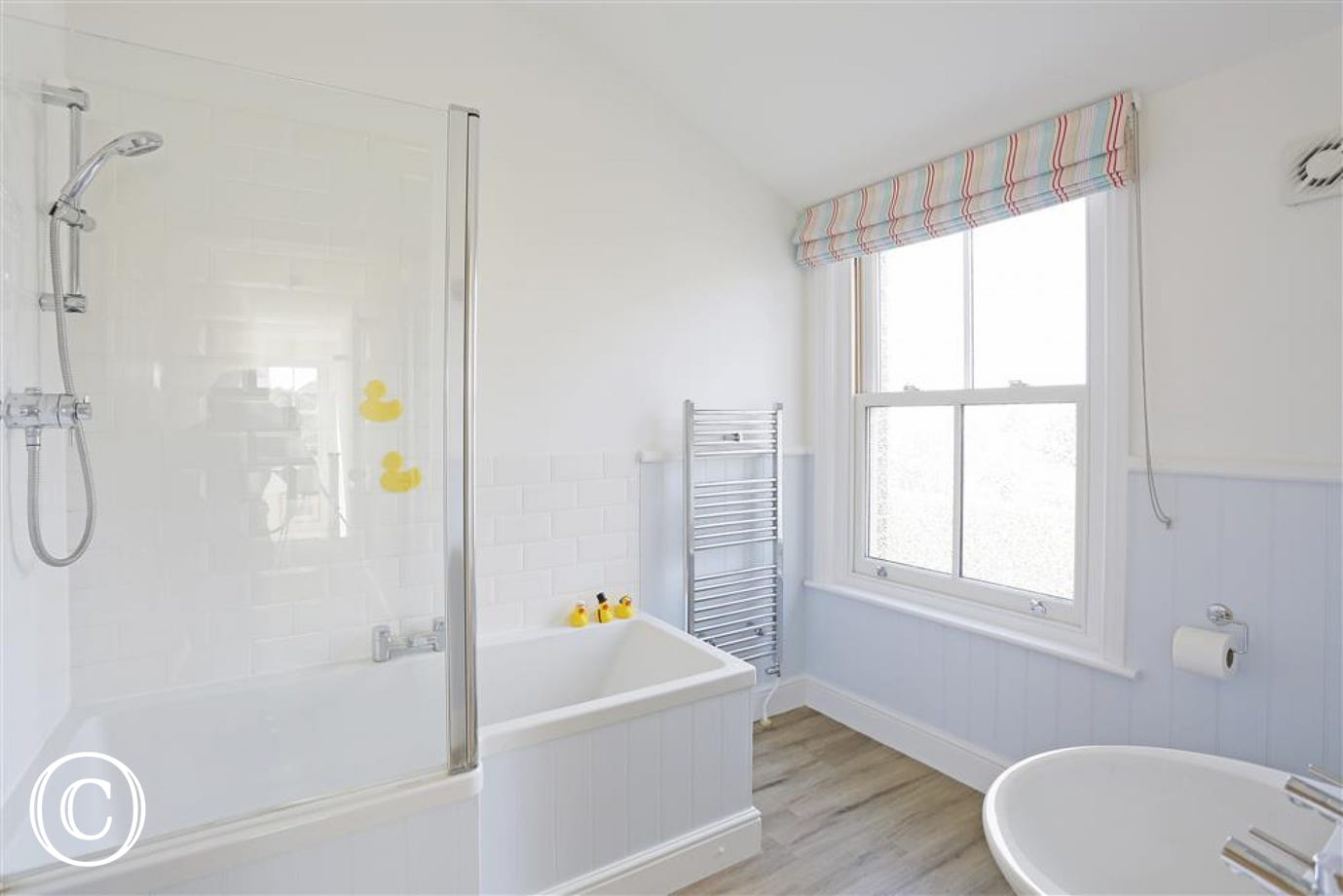 A superb family sized bathroom with trendy bath complete with overbath shower.