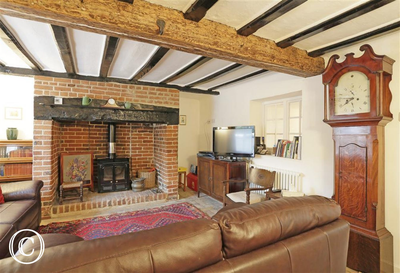 Relax in front of the television in front of the woodburner after a day sight seeing in the local area.