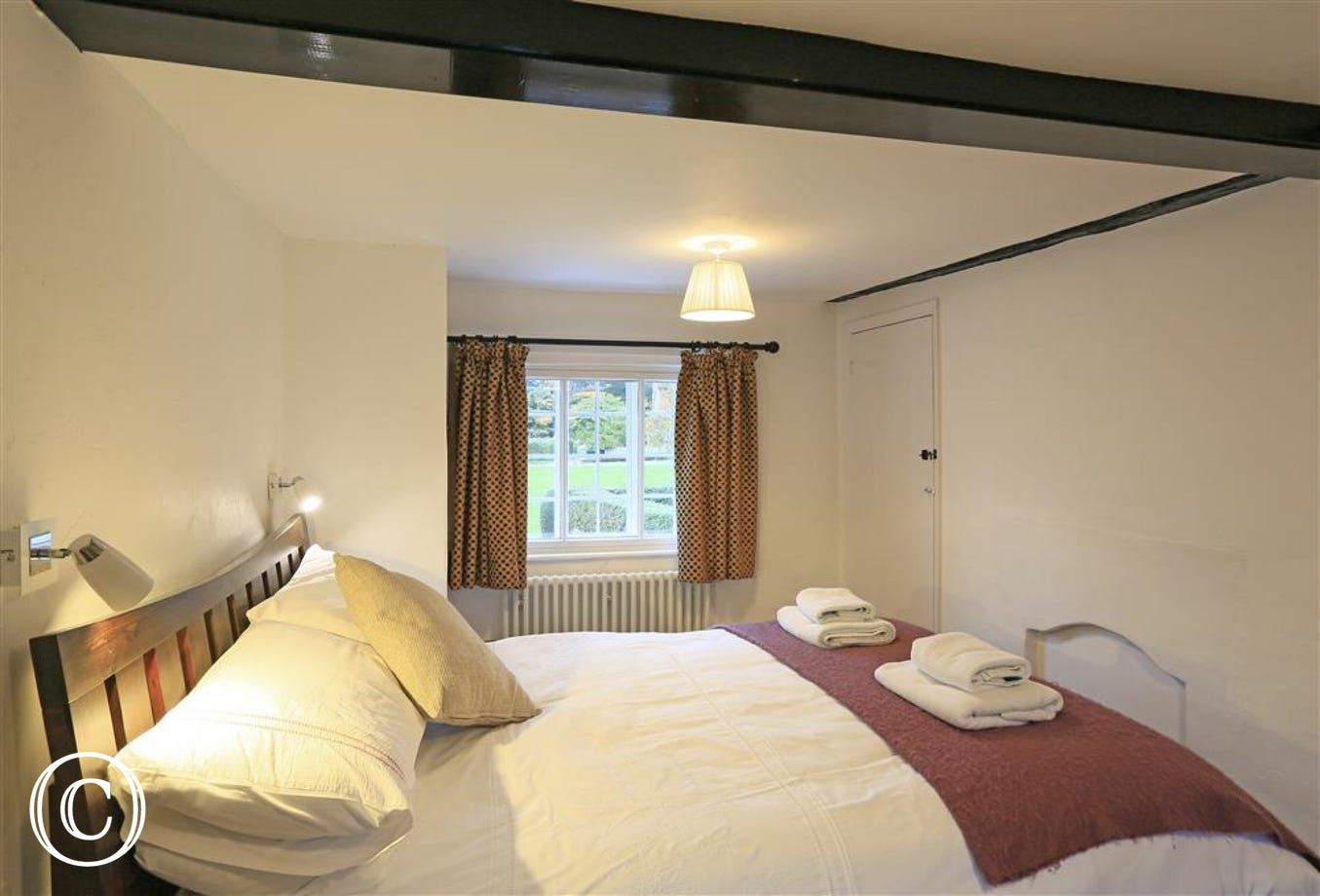 With beams throughout the property, this bedroom has a wonderful cosy feel.