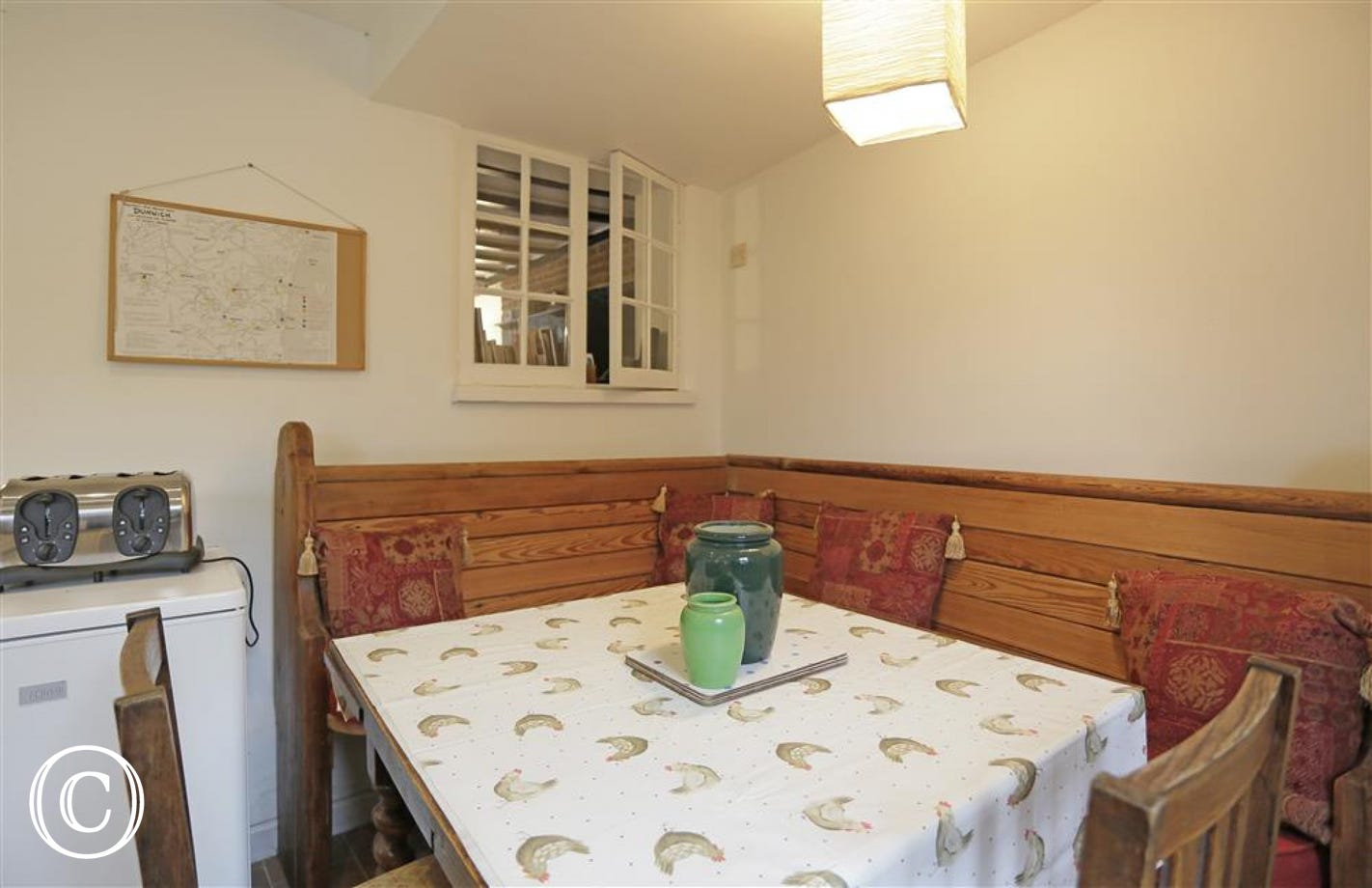 The dining area of the kitchen offers space for families and friends to sit together during meal times.