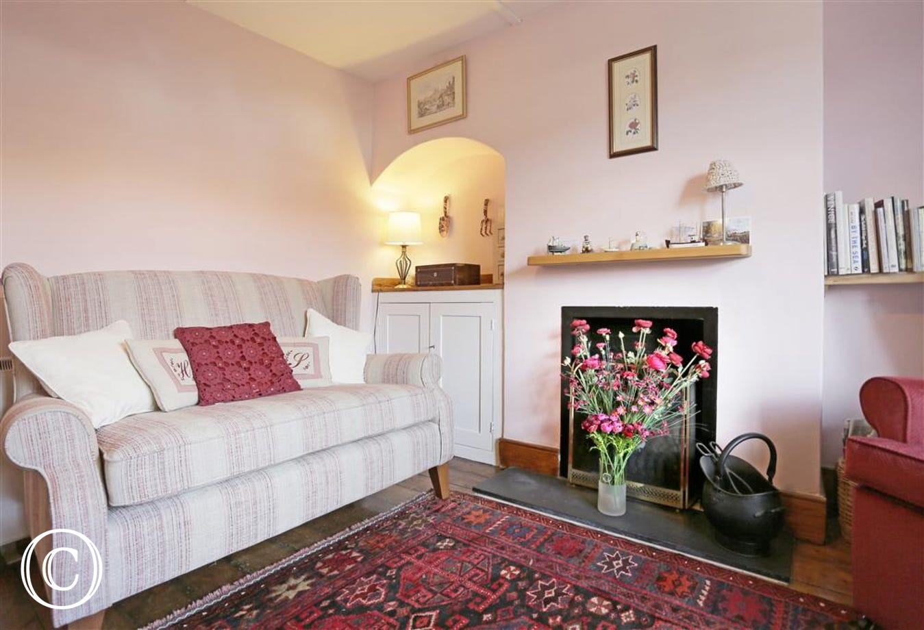 This cosy sitting room has an open fire for those chillier nights.