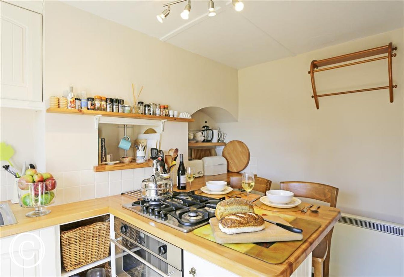 This quaint kitchen will be the hub of the cottage for tea in the garden or at the table.