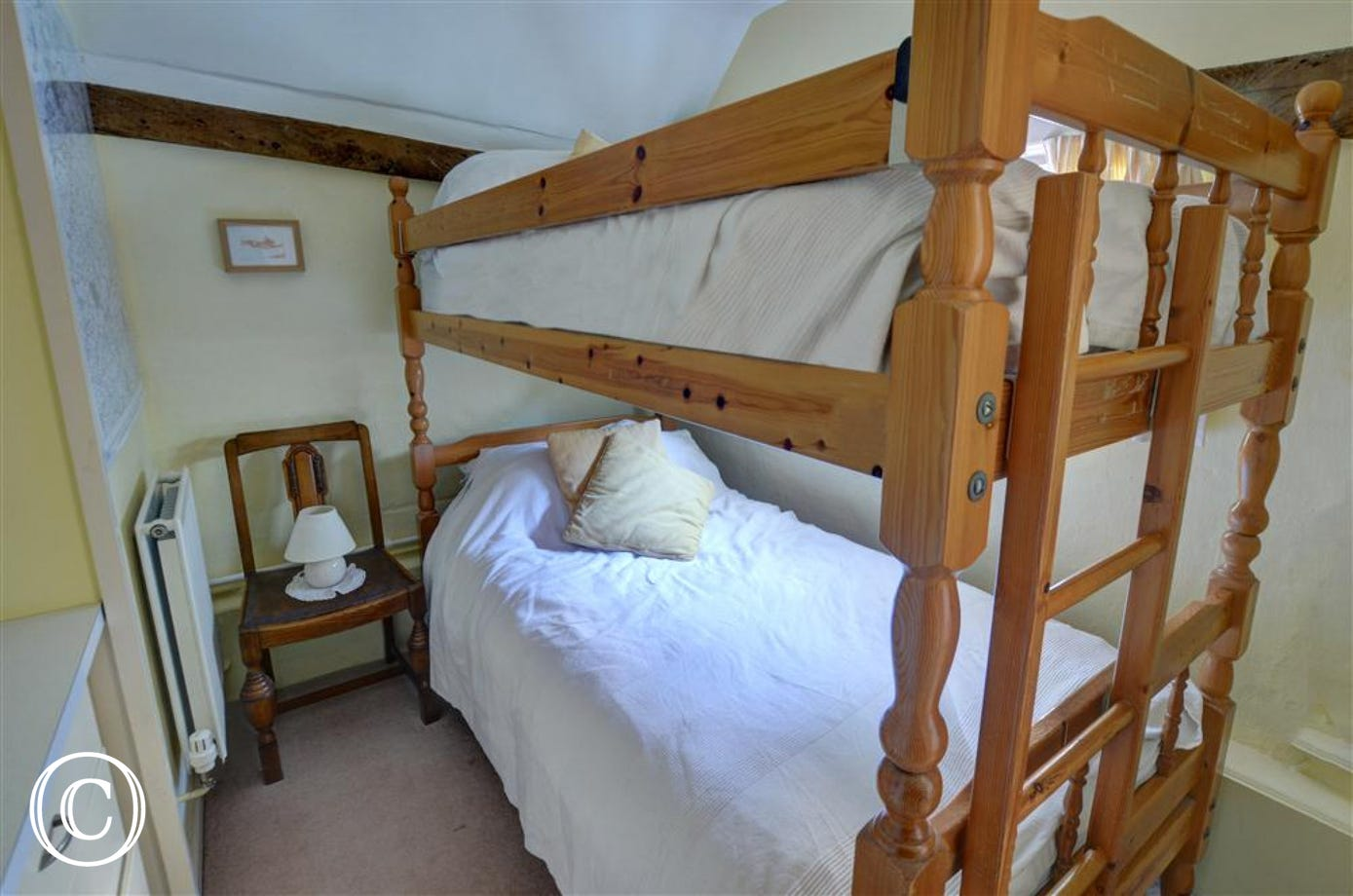 This bunk bedded room will suit two children down to the ground and is located off the kitchen.
