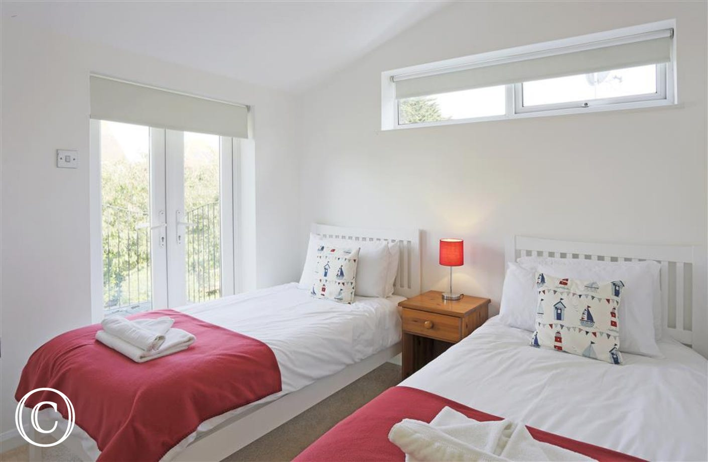This is the first of two twin bedded rooms and this room has a set of patio doors so you can go out onto the balcony.