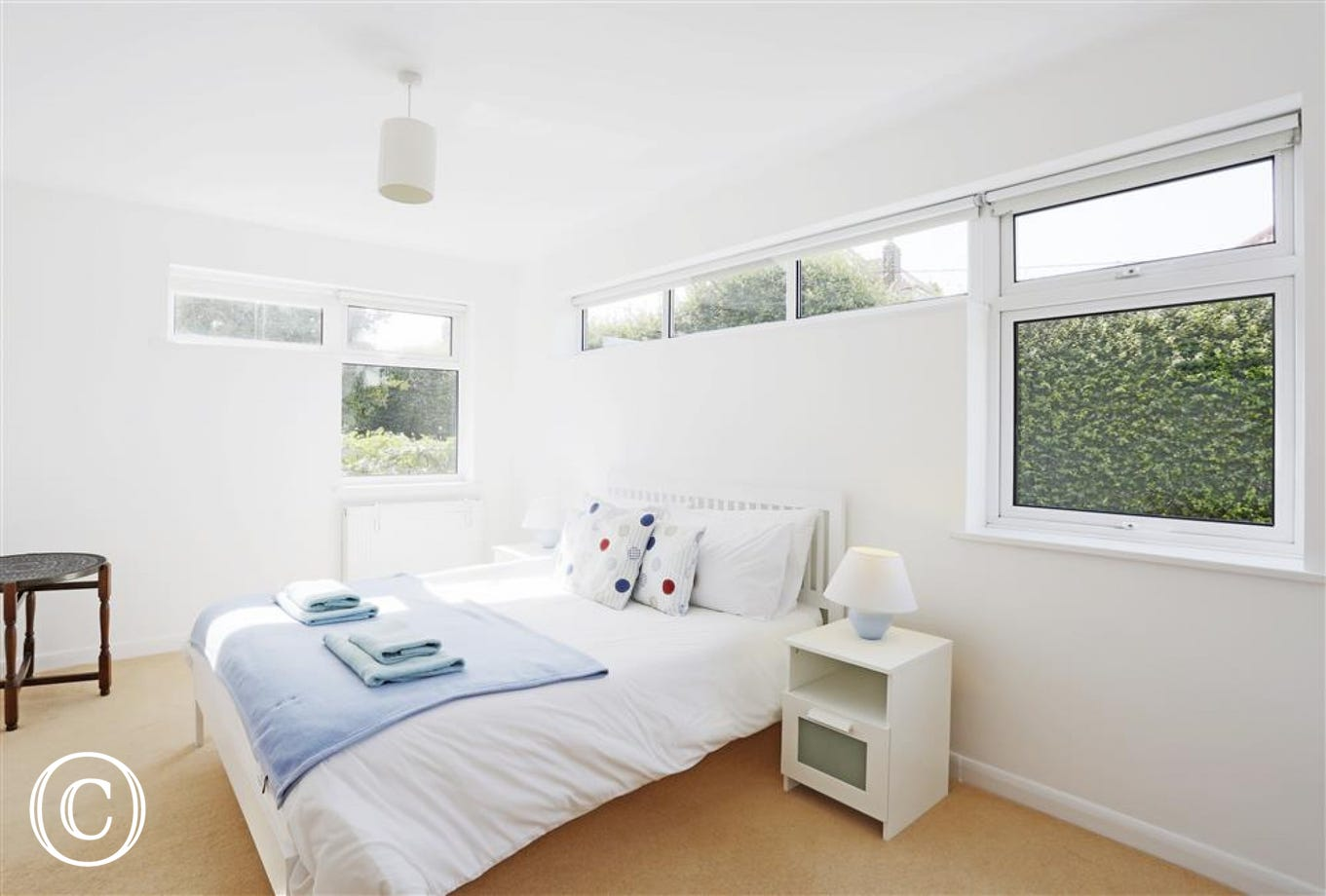 This double bedded room on the first floor has a view into the garden below and plenty of wardrobe space.