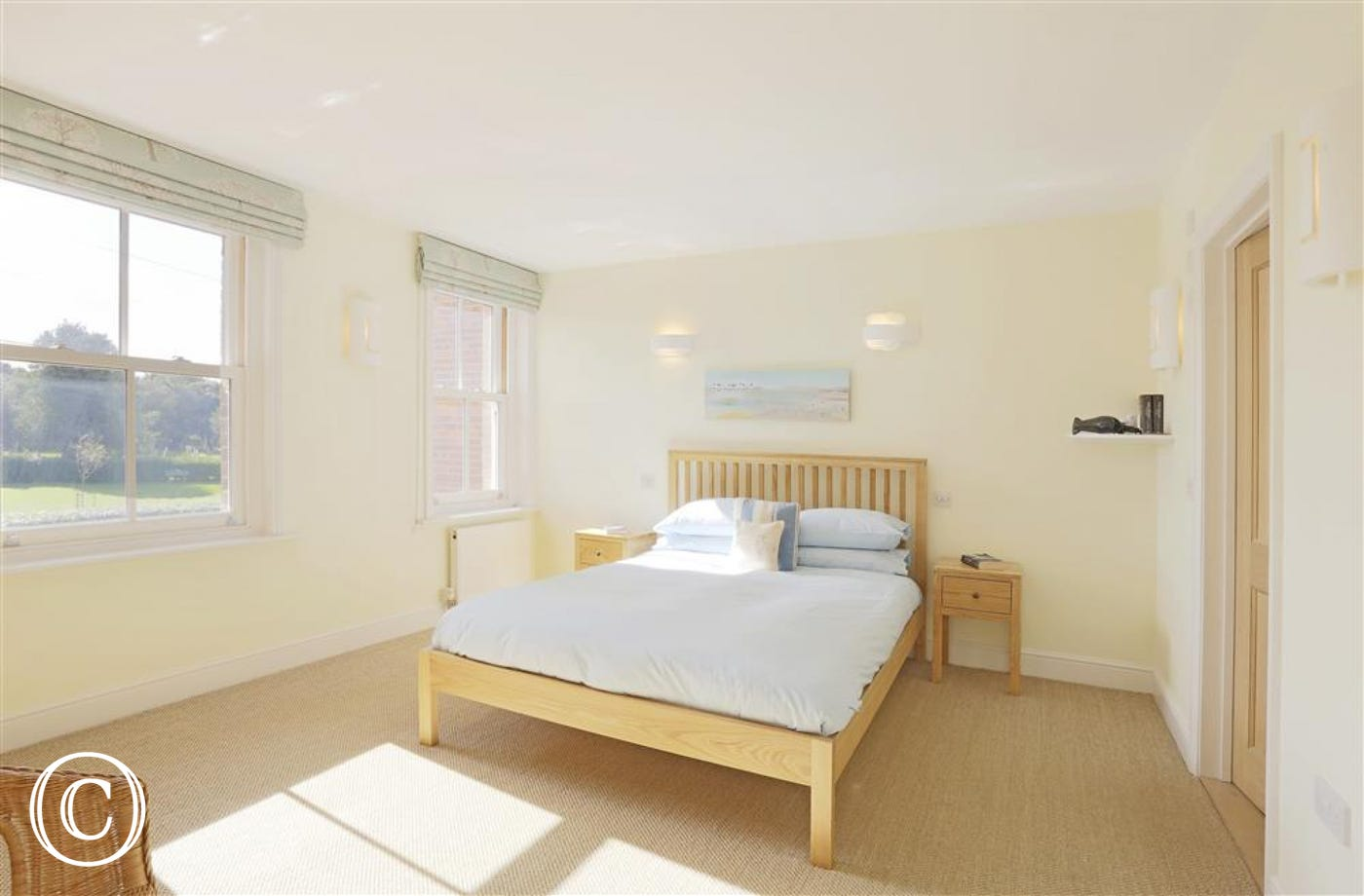 This king-sized bedded room has a nice view of the church green and the roof tops beyond with access to an en-suite.