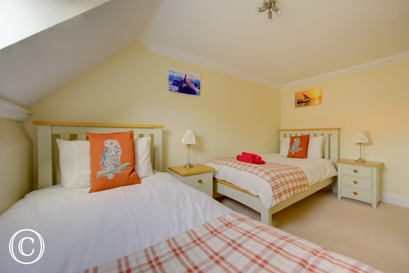 The red gingham throws on these twin beds will provide extra comfort whilst staying at Wisteria.