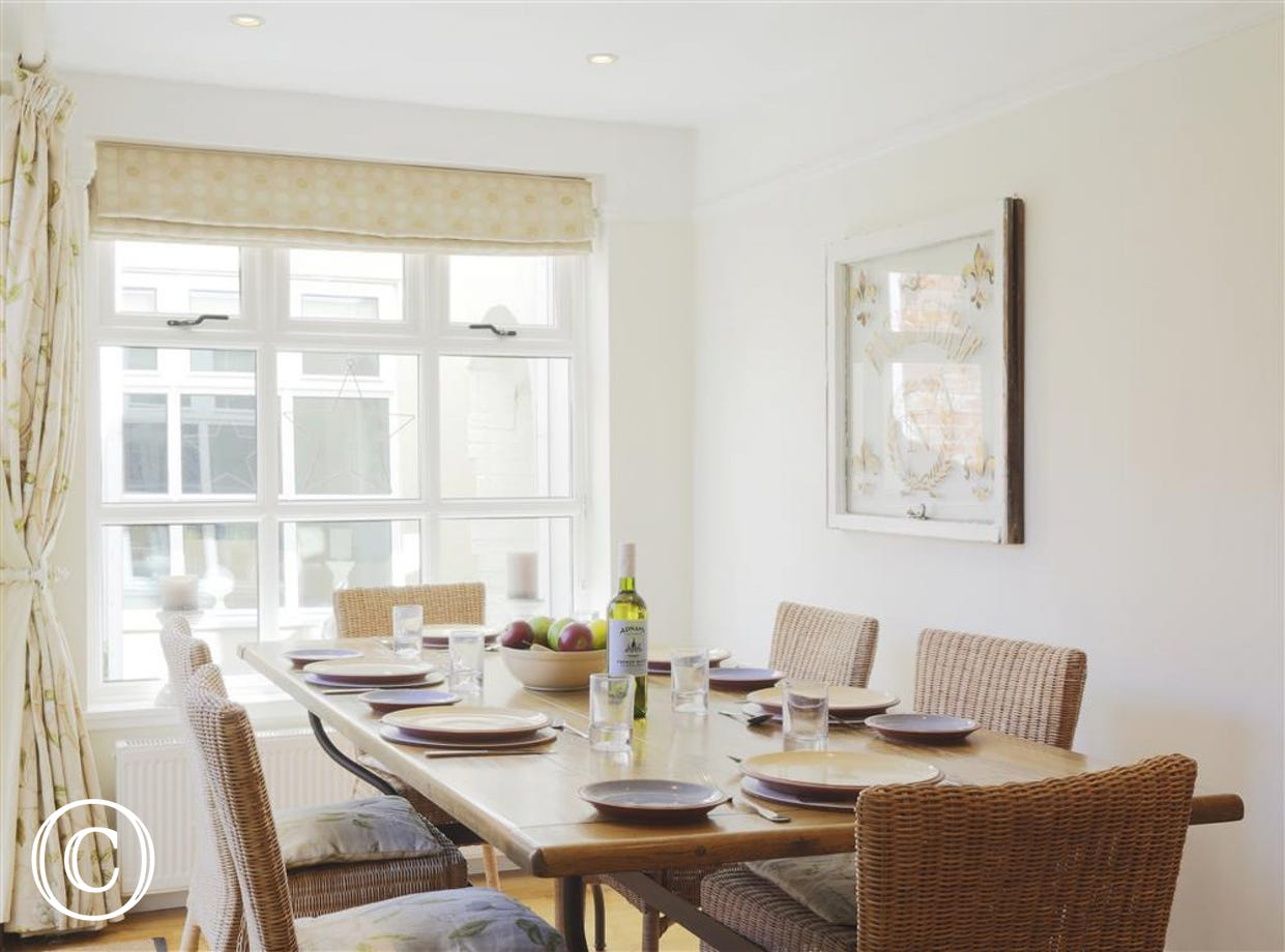 The dining area is located in the kitchen with a bright view of the courtyard garden.