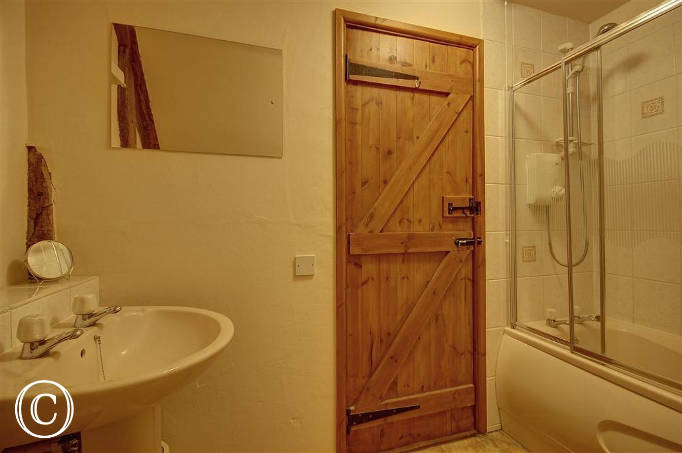 A perfectly sized bathroom with added overbath shower facility.