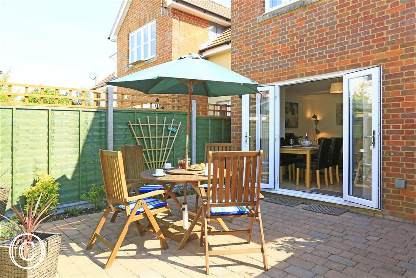 This fenced garden area is ideal for relaxing during the warm summer sun. Put up the parasol and enjoy this area at its best.