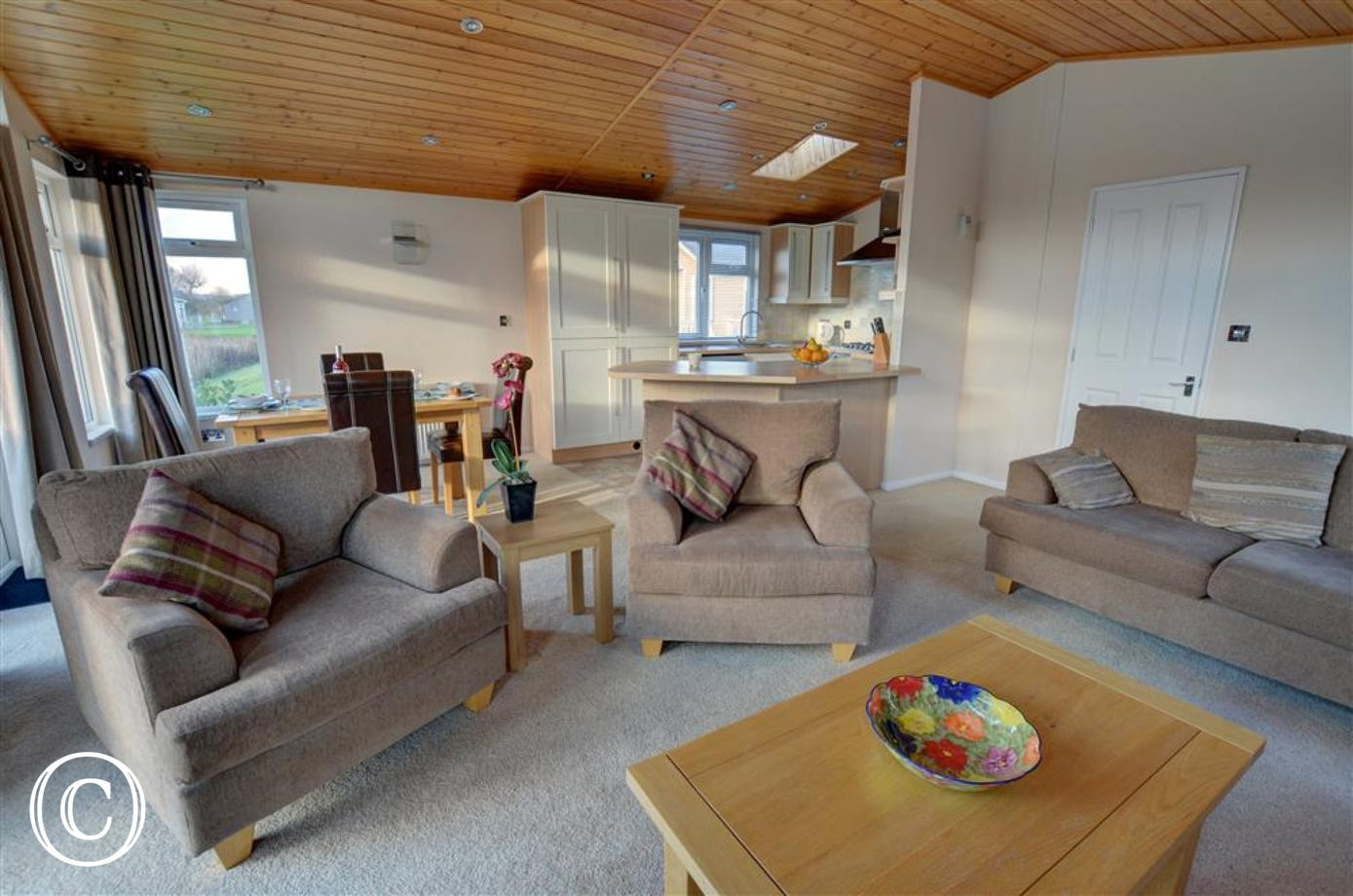 Enjoy this open plan and easy to use sitting area with dining area and kitchen.