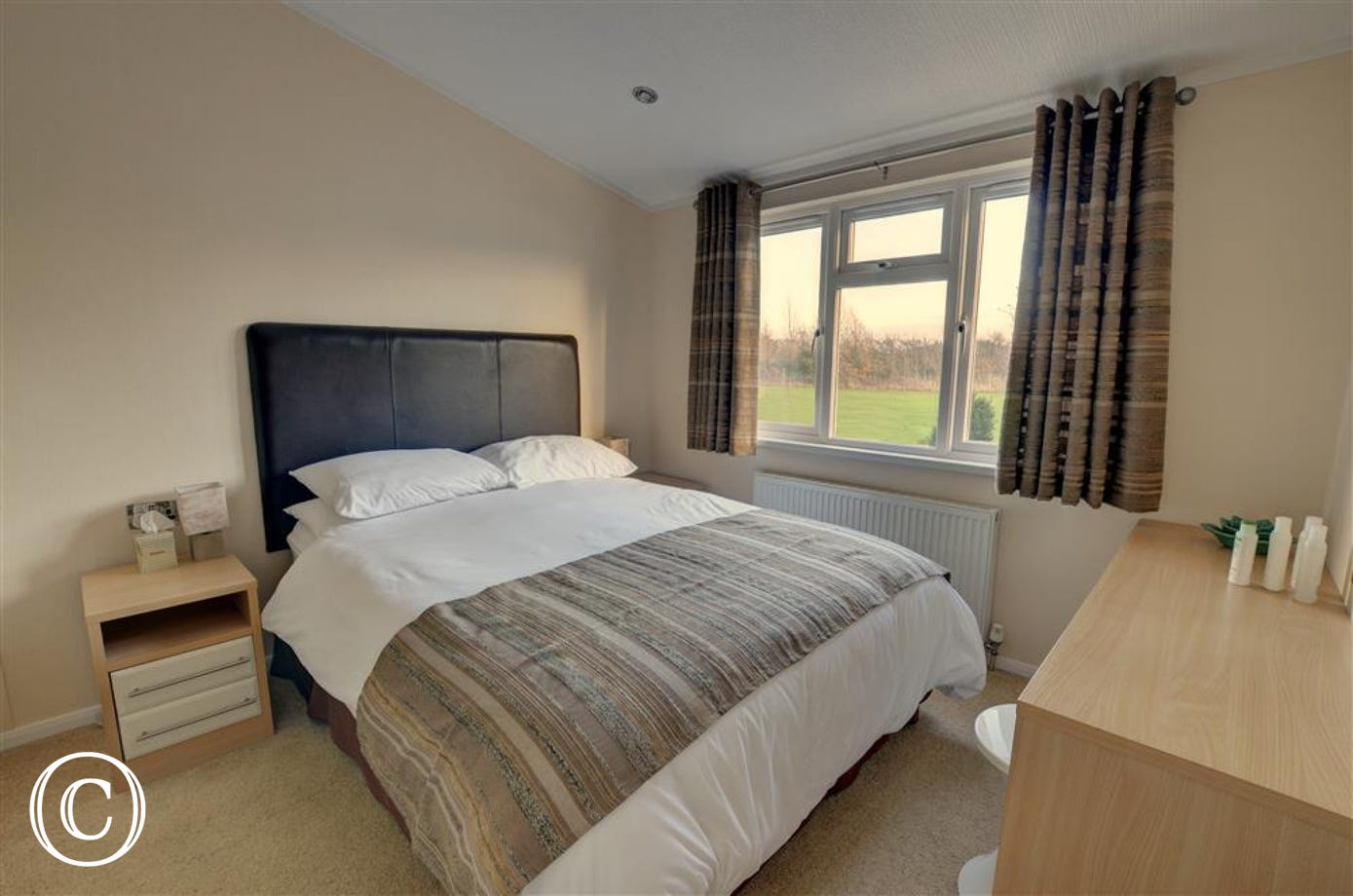 This main double bedded room with views over the lawn areas and dressing table will mean you can get ready for those country walks.