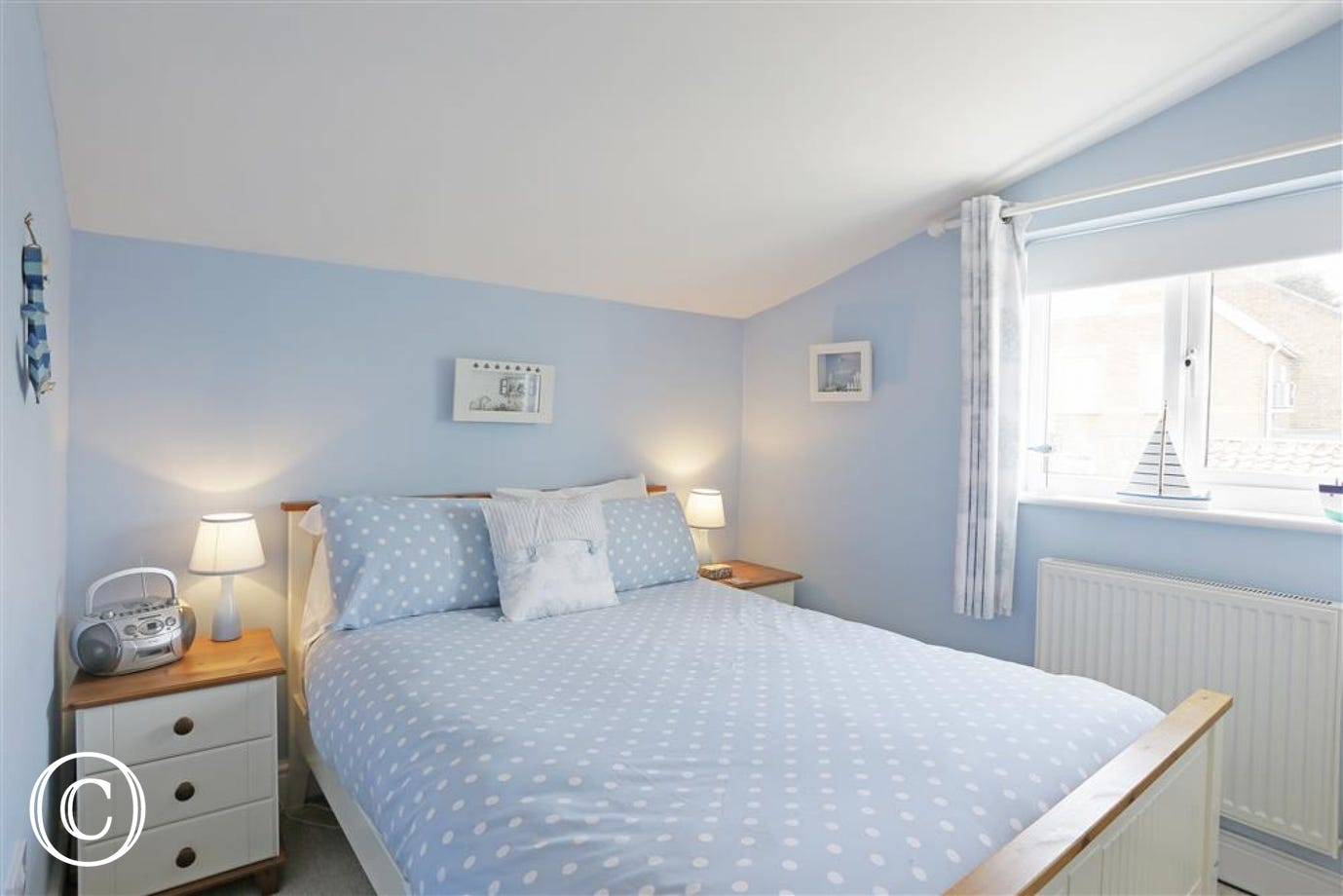 This room which is one of three bedrooms has a double bed and serene aura.