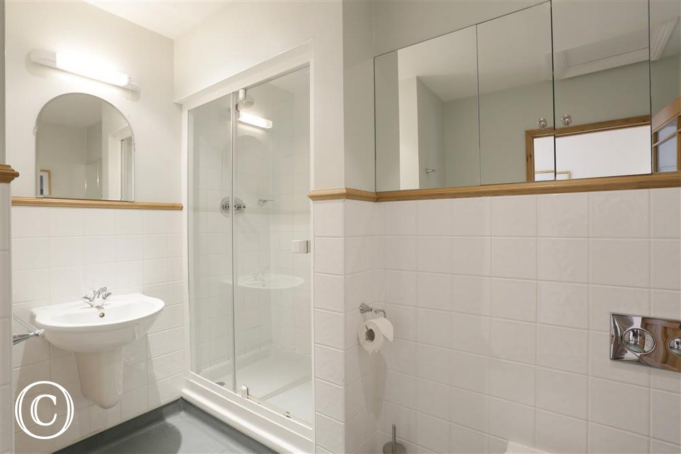 This shower room is on the first floor between the two bedrooms.