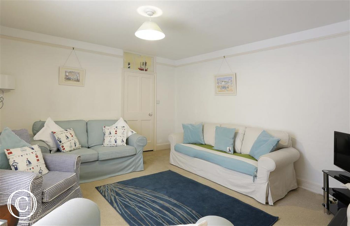 Relax in this room with a choice of different sofas and chairs.