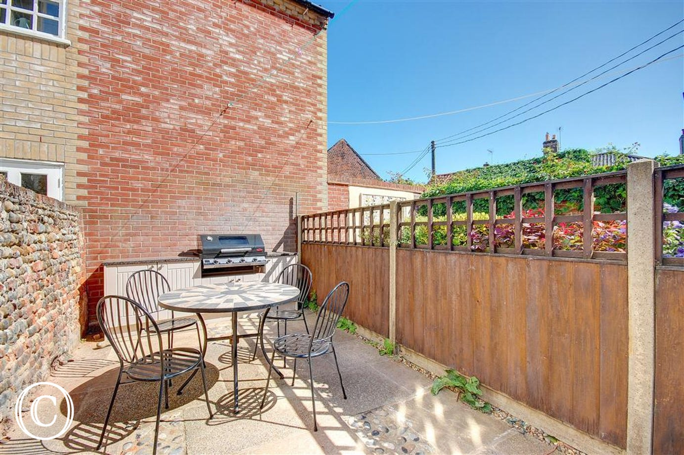 Enjoy the Southwold sunshine in this courtyard garden with added bonus of fitted BBQ kitchen.