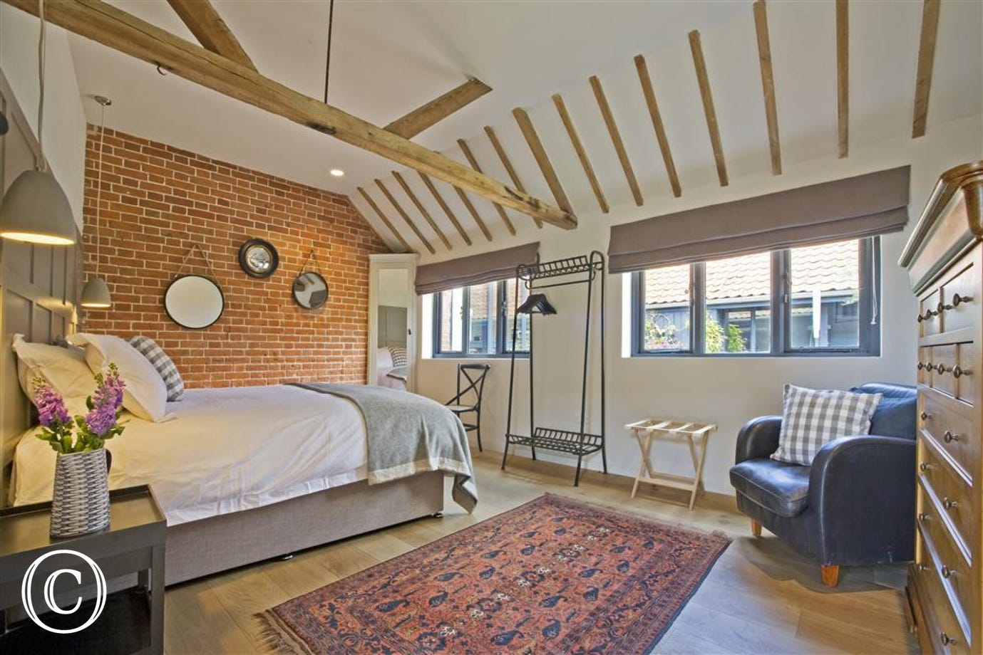 The accommodation in the barn is flexible with three ground floor bedrooms and two shower rooms and two bedrooms with ensuite bath/shower rooms on the first floor