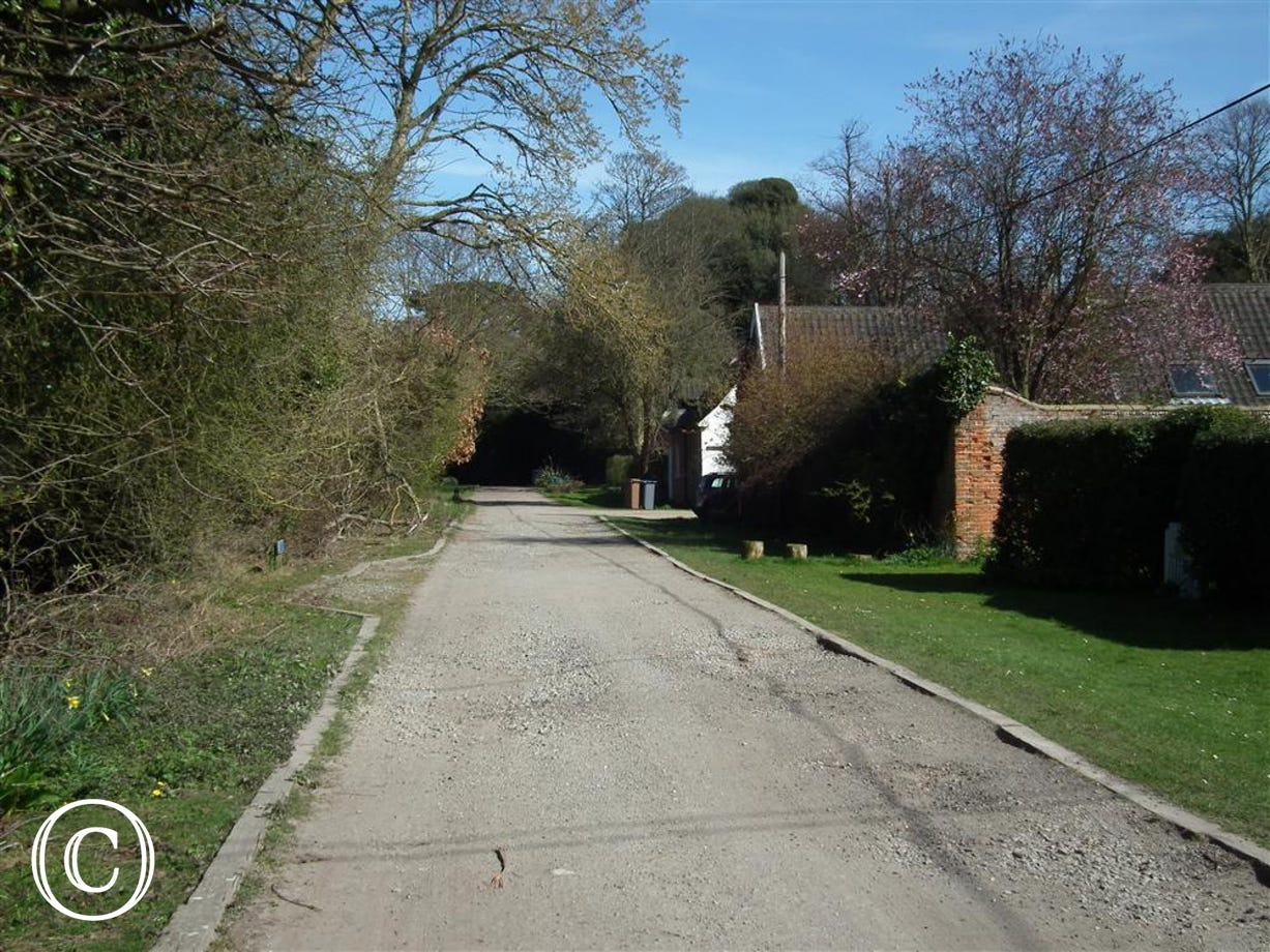 This is Long Row Lane which takes you down to the woods and cliffs
