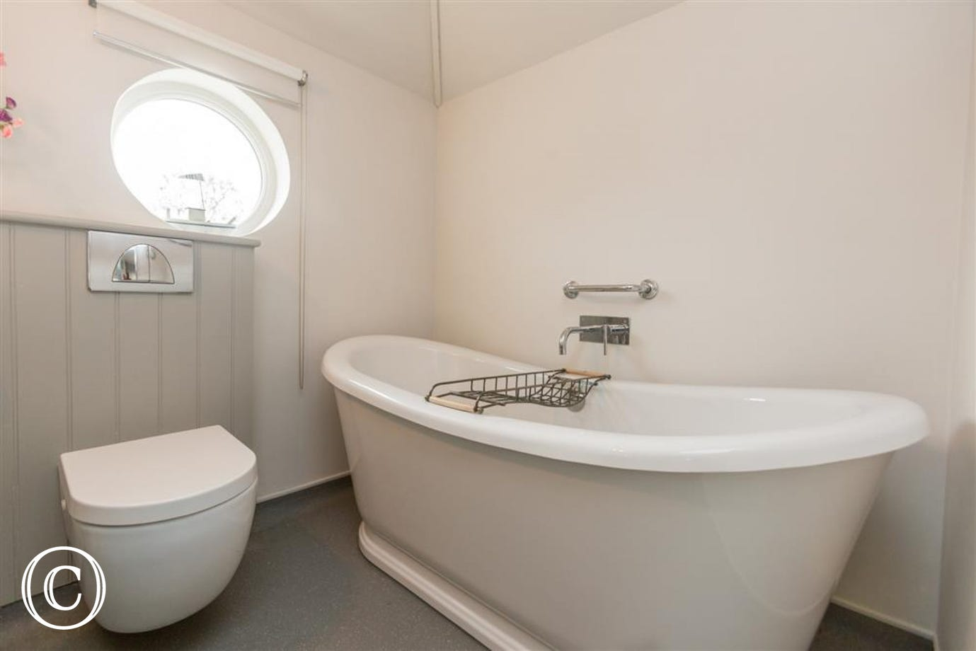 The bath in the bathroom accessed from the twin bedroom