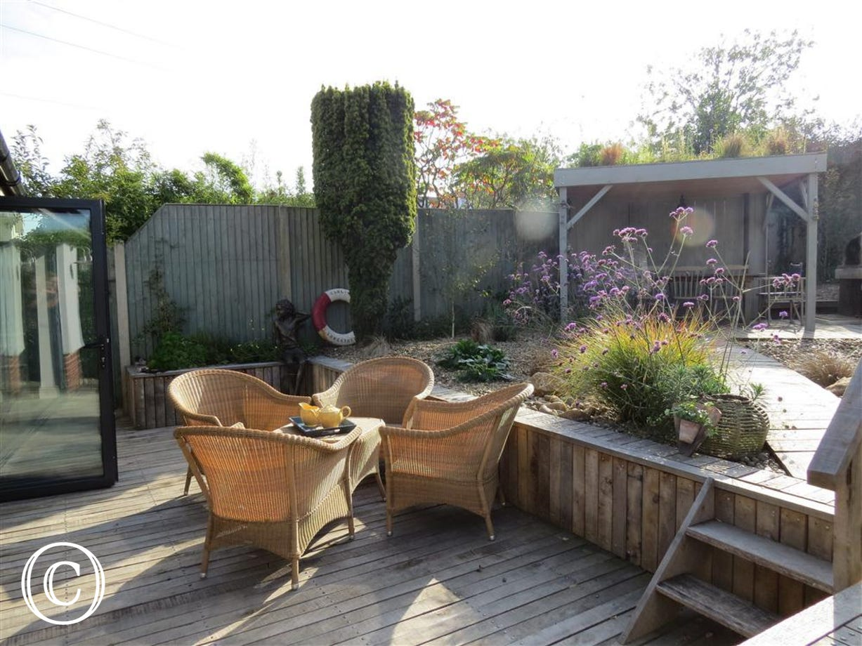 Nearly a full view of the garden and decking terrace