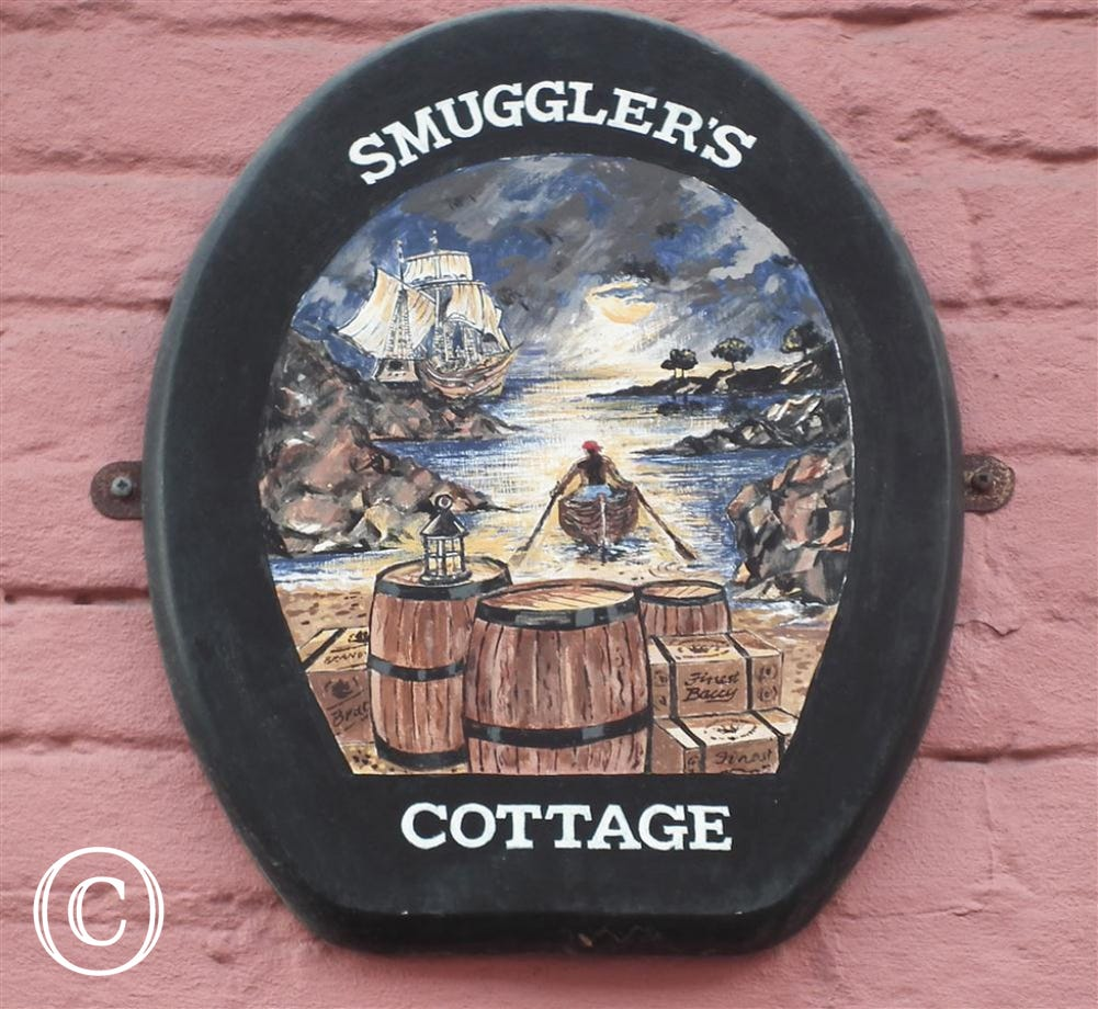 This sign was commissed by the owners of Smugglers.
