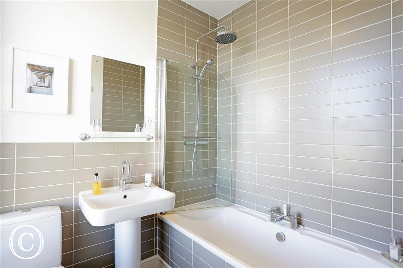This sophisticated en-suite can be accessed from the master bedroom.