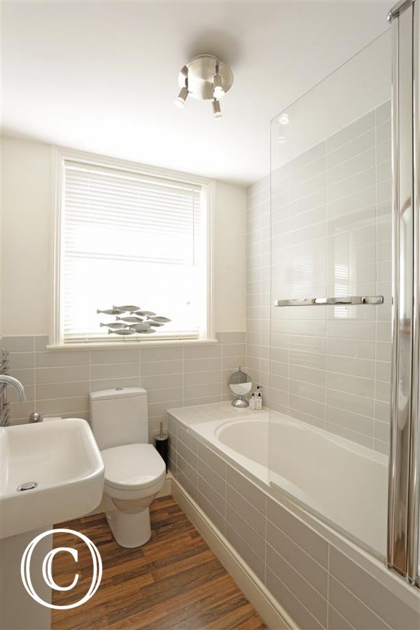 This fresh family bathroom with light grey seaside shades is sure to help you re-group.