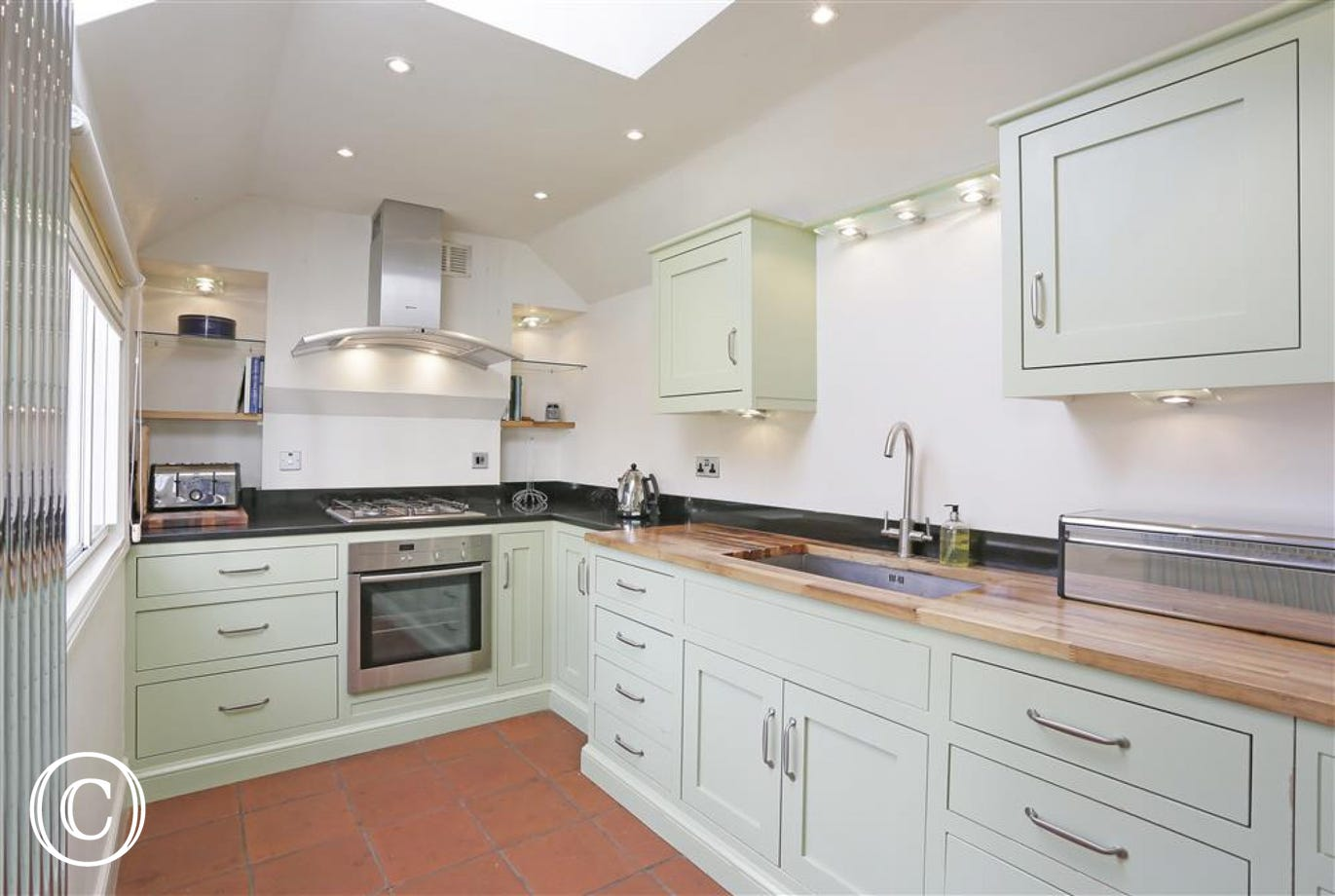 This apple green kitchen is sure to have everything you need for your self-catering stay.