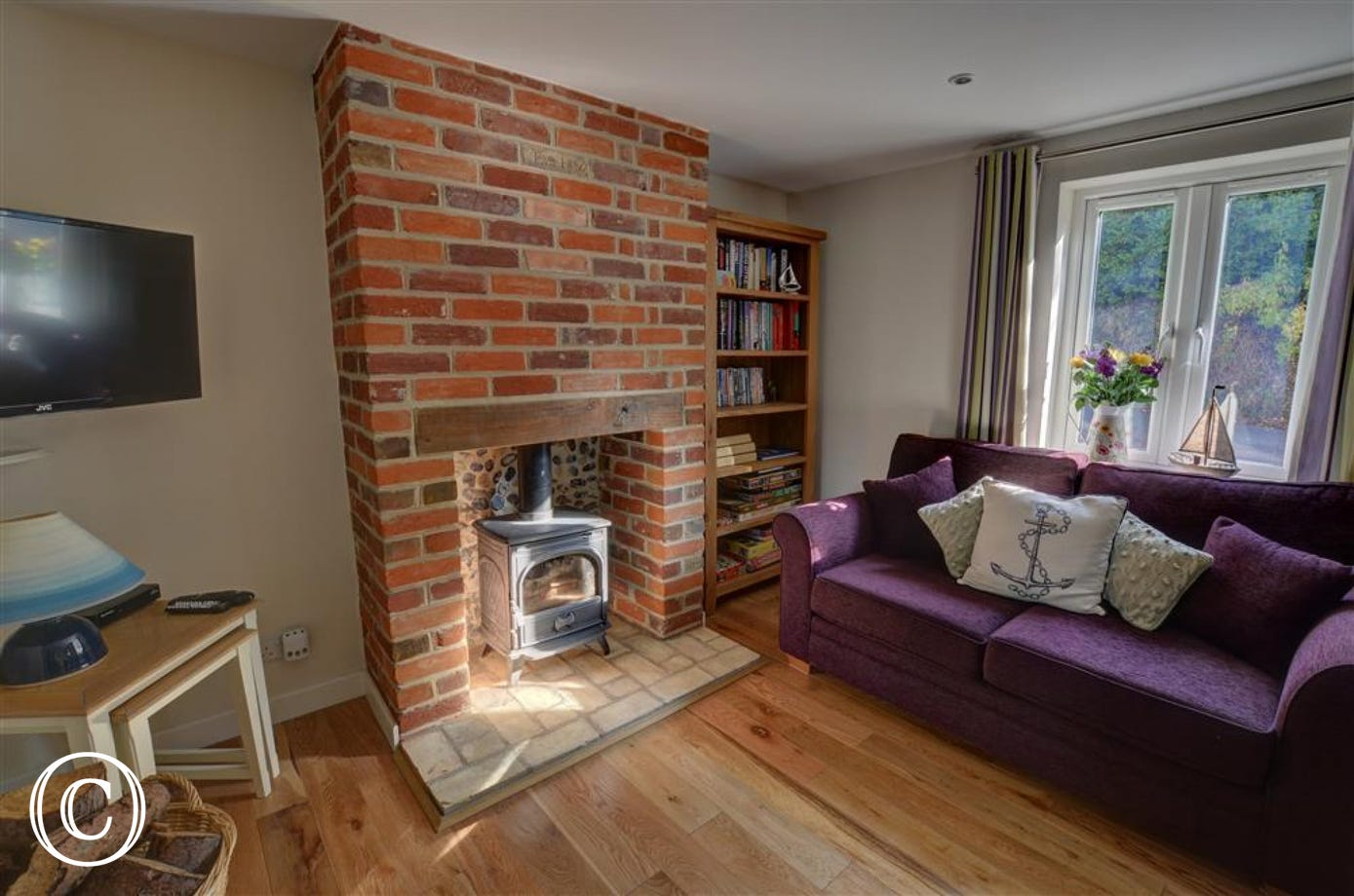 Enjoy the rustic charm of the wood burner in the red brick surround in the sitting room.