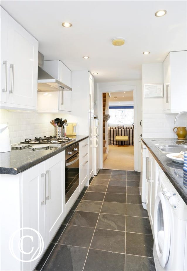 From the open plan Sitting Room and Dining Area you'll lead into this fully equipped modern kitchen.
