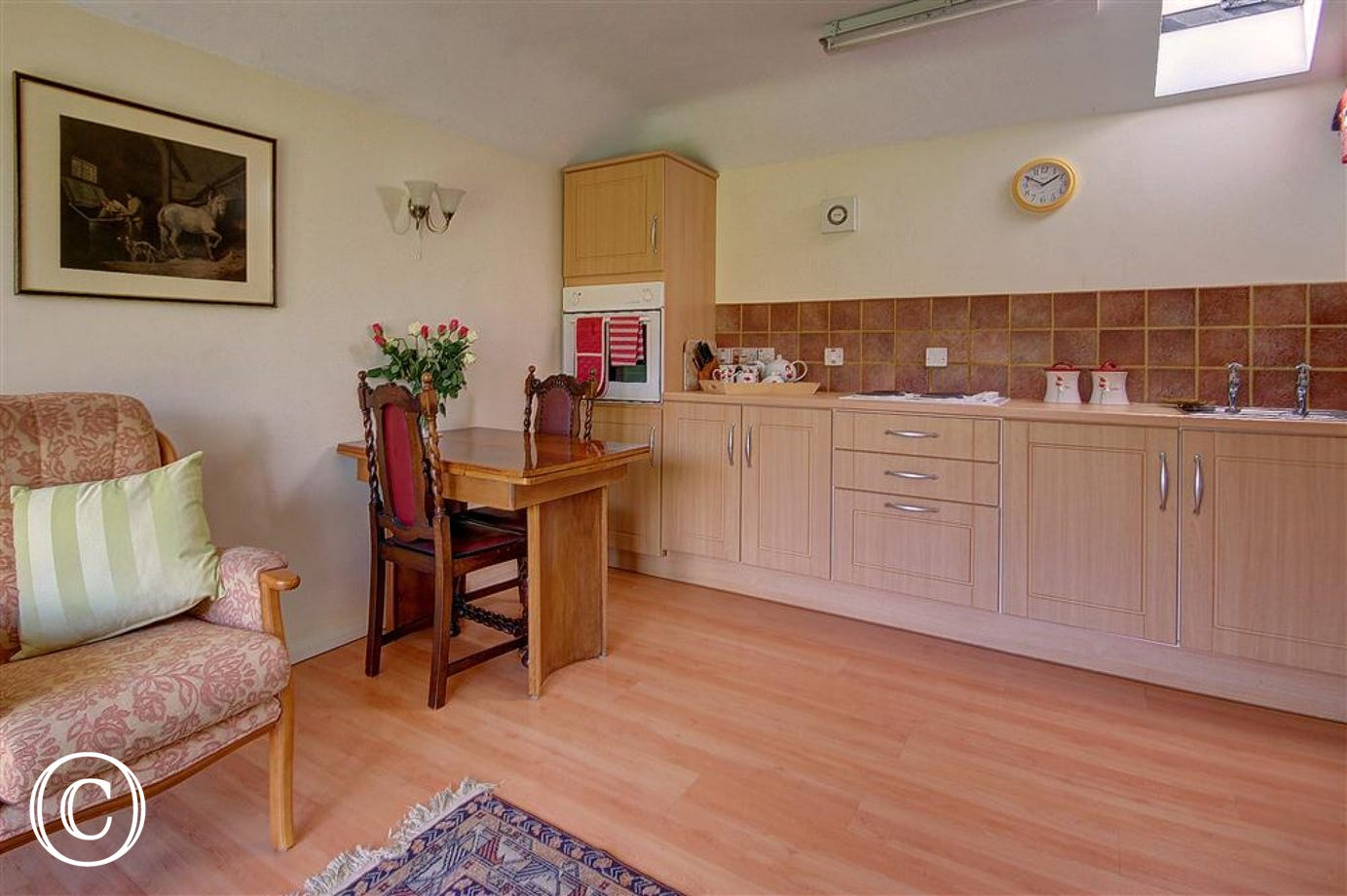 Enjoy cooking in this open plan kitchenm right next to the dining area, making serving that bit easier.