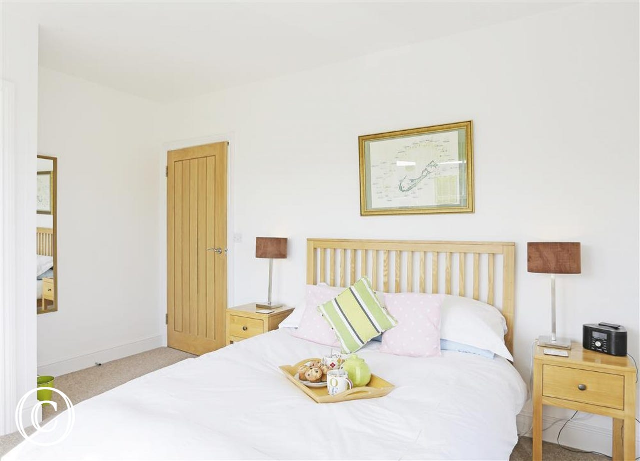 A welcoming double bedroom awaits you after a busy day out and about.