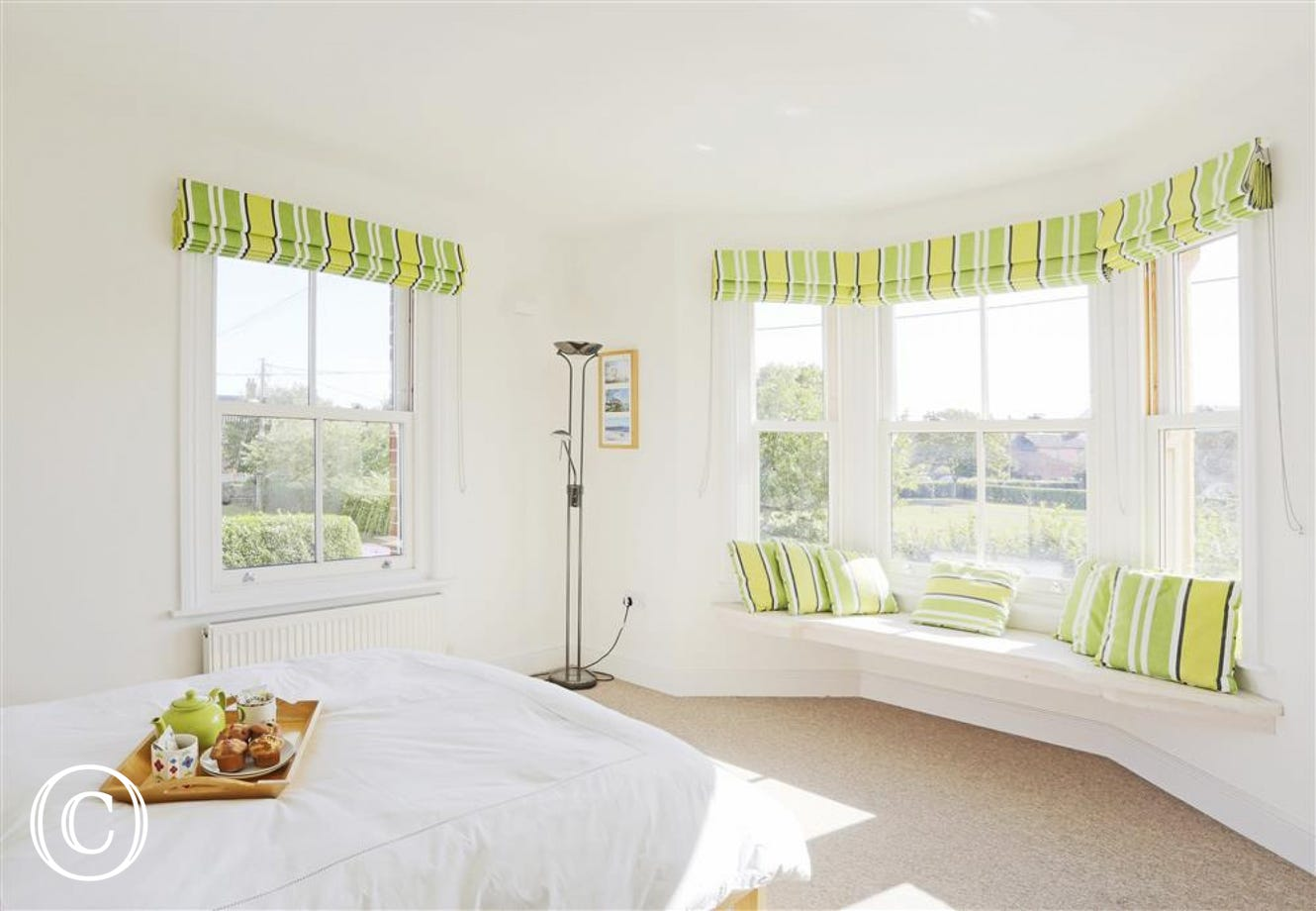 Sink into this divine bed and enjoy the spectacular views out onto St Edmunds Green.