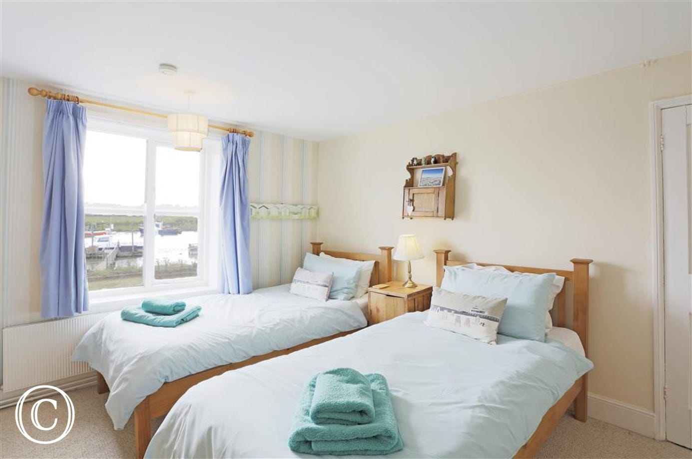 This twin room is one of three bedrooms providing comfort and luxury.