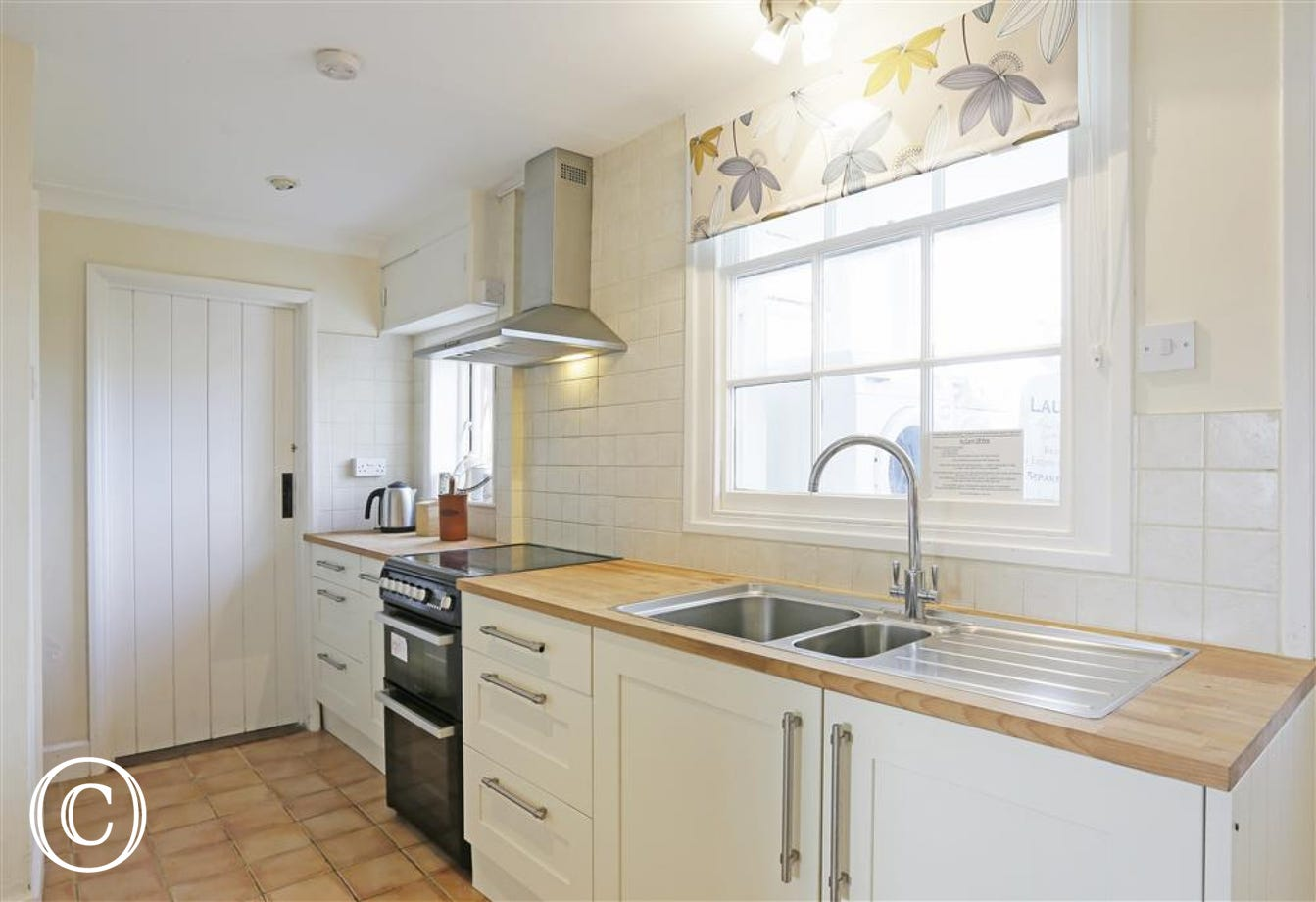 The kitchen is light and airy with views over the common